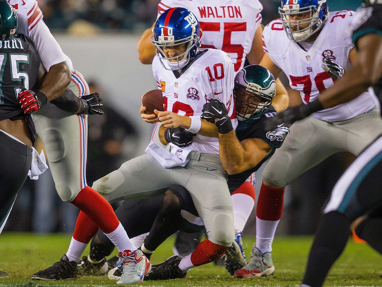 Eli Manning is pulled down by an Eagle defender on a night in which the New York Giants suffered eight sacks.