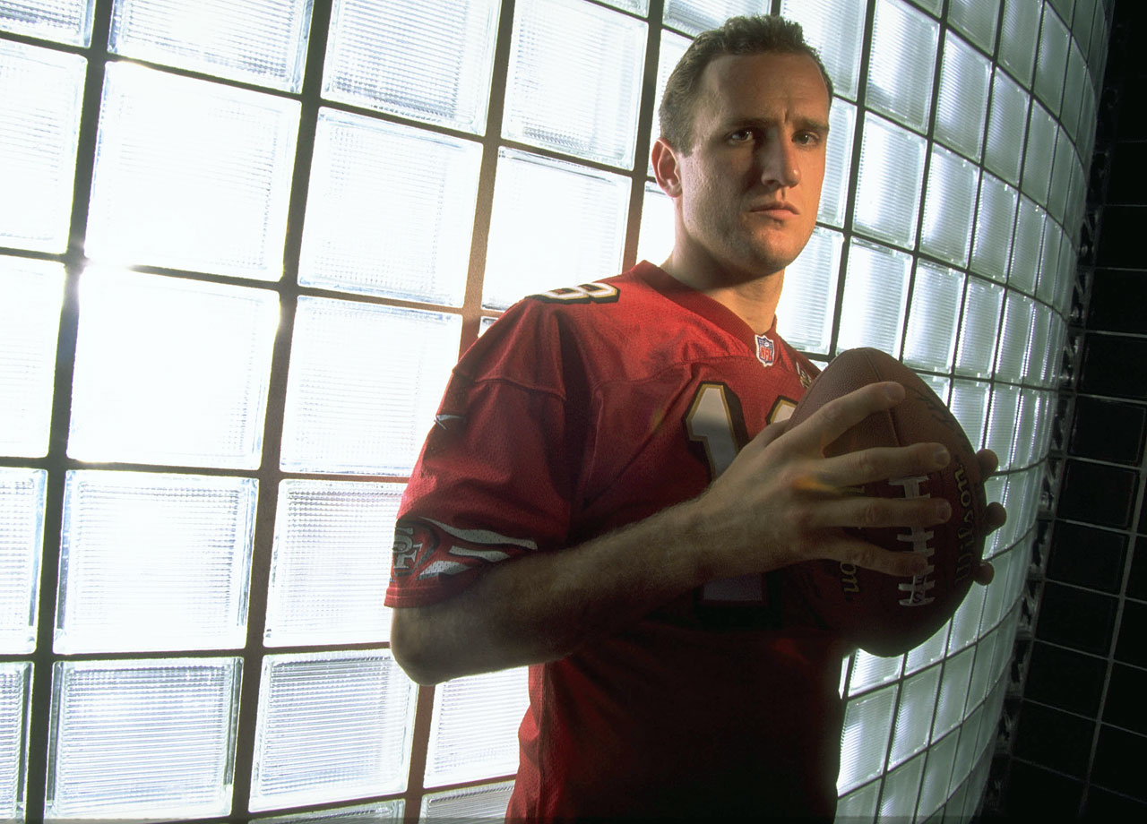 "Leaping tall buildings in a single bound might be stretching it. But if you needed a missile aimed with laser-like precision by a stalwartly handsome guy with a crew cut and a chiseled jaw, Kansas City Chiefs quarterback Elvis Grbac was your man. ""I never pictured Elvis as a ladies' man,"" stated his University of Michigan coach Jerry Hanlon. Then again, Grbac never had time: The Cleveland native—yes, named after that Elvis by his Croatian-born parents—was still in high school when he began dating wife Lori, with whom he now has three children. Though he had met interesting and famous people, said Grbac, ""no one compares to her."" Lucky Lori knew why he's her superhero: ""His personality makes him sexy."""