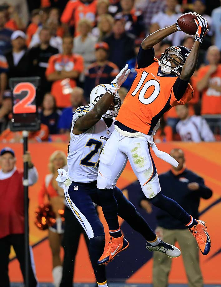 Wide receiver Emmanuel Sanders of the Denver Broncos pulls down his third touchdown catch of the game over cornerback Shareece Wright of the San Diego Chargers during the Thursday night game.