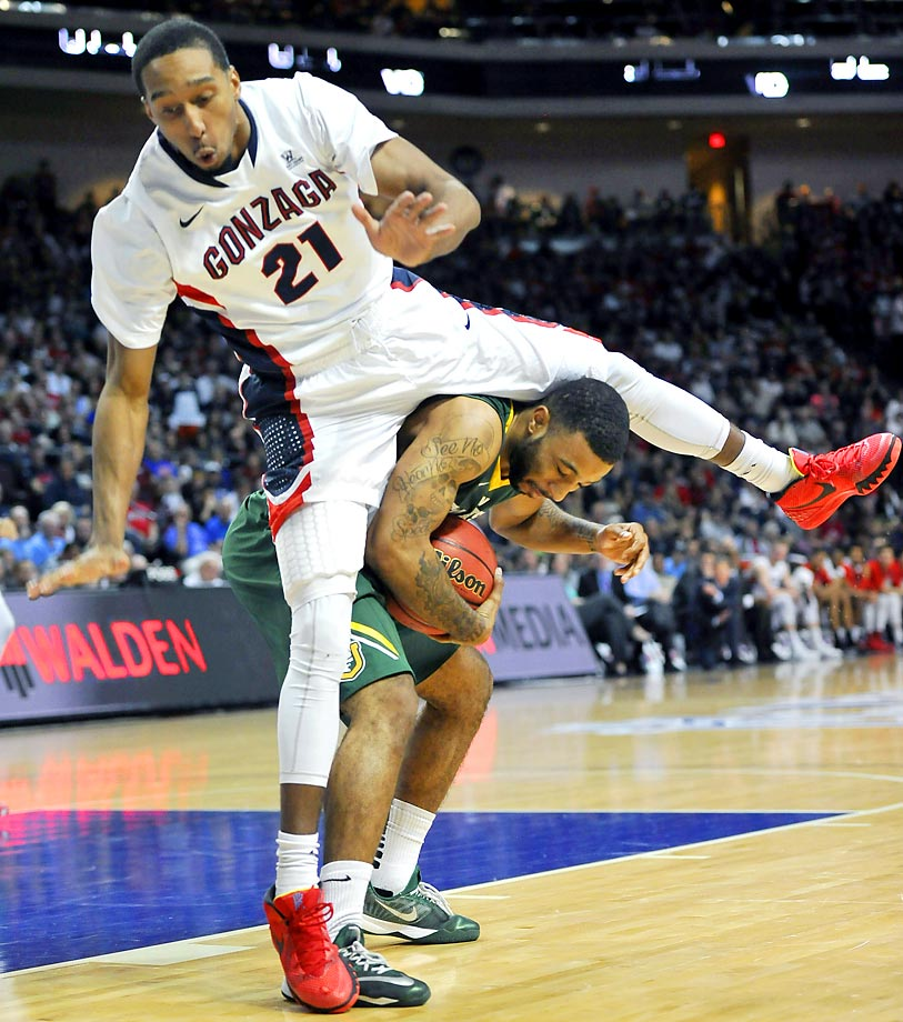 Gonzaga's Eric McClellan tries to hurdle San Francisco's Corey Hilliard.
