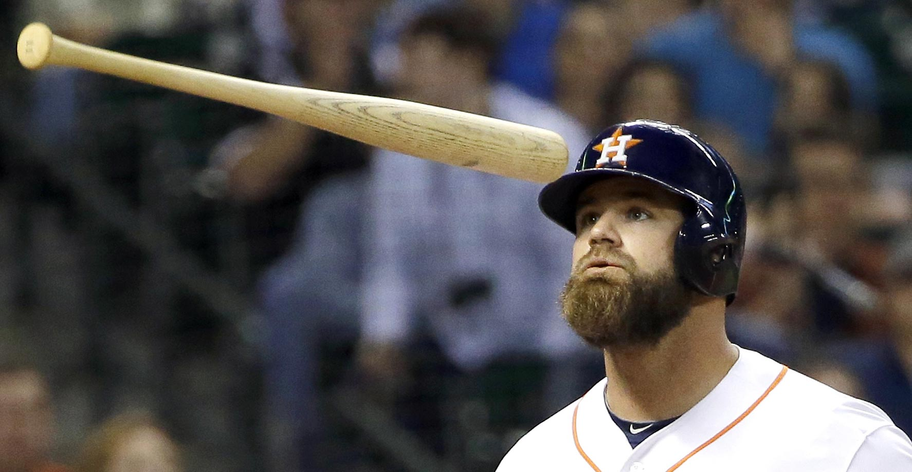 Evan Gattis of the Houston Astros tosses his bat after striking out against the San Francisco Giants.