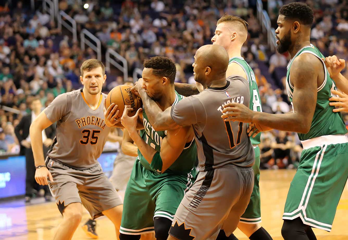 PJ Tucker and Evan Turner fight for a rebound in the final minute of the Suns vs Celtics game.