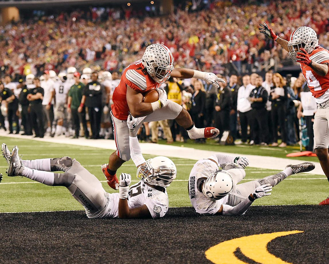 Led by third-string quarterback Cardale Jones and overlooked running back Ezekiel Elliot, Ohio State crushed Wisconsin to sneak into the first ever College Football Playoff, then upset Alabama and Oregon to capture the title. The Buckeyes dispatched the Ducks 42-20 in the championship game behind Jones' 242 yards passing and Elliot's 246 yards rushing to give coach Urban Meyer his third national title and first at Ohio State.                                      (Text credit: Alex Putterman/SI.com)