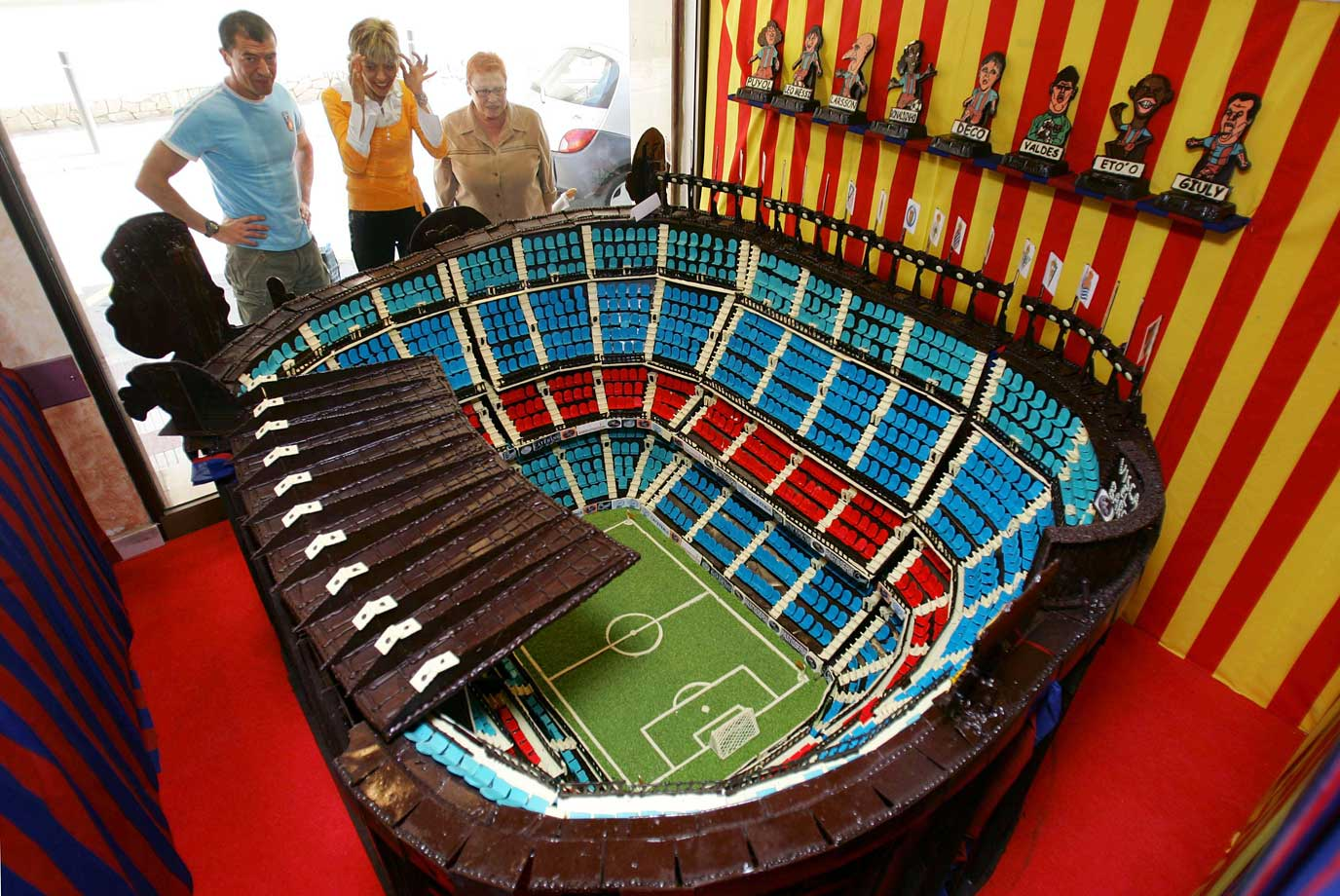 Fans marvel over a chocolate replica of FC Barcelona's Stadium, Camp Nou Stadium, at Bosch Pastry Shop in Pineda de Mar, near Barcelona. The edible stadium was made of nearly 700 kilograms of chocolate.