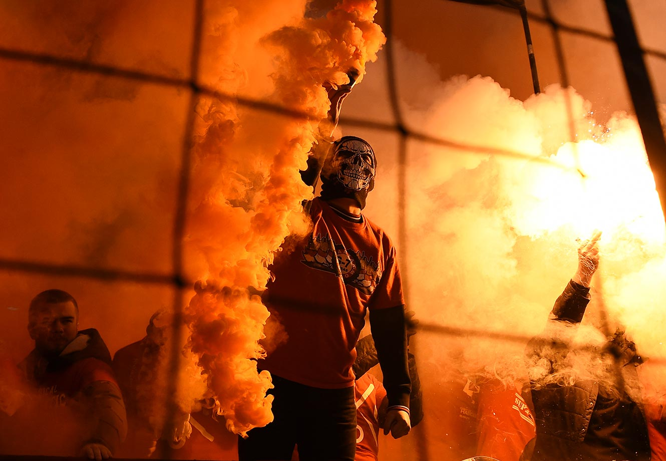 FC Spartak Moscow fans light flares during the Russian Premier League match between FC Spartak Moscow and FC Krylia Sovetov Samara.