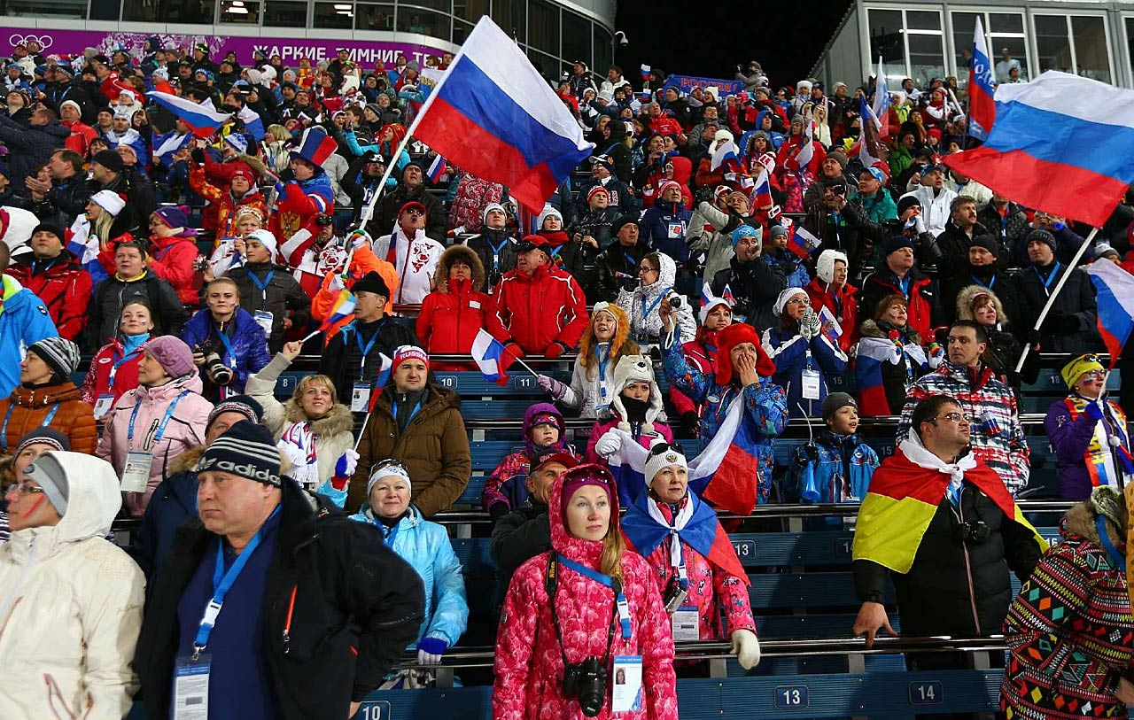 Russian hockey fans pose inside Olympic Park.