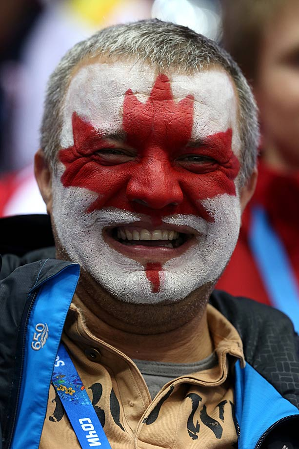A Canada fan attends the hockey semifinal game between Canada and the United States.