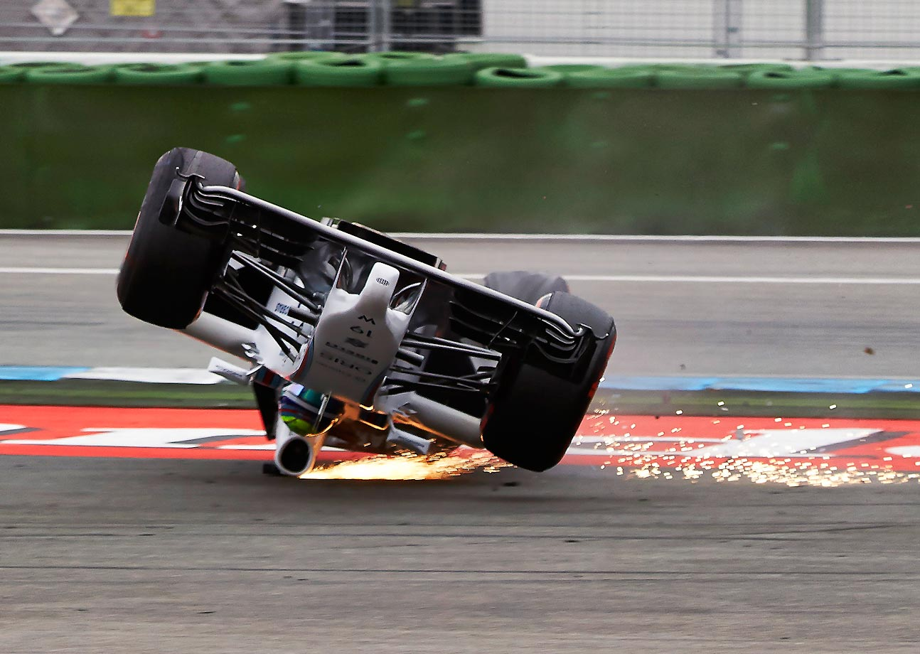 Felipe Massa flips his car going around the first corner at the the German Grand Prix in Hockenheim.