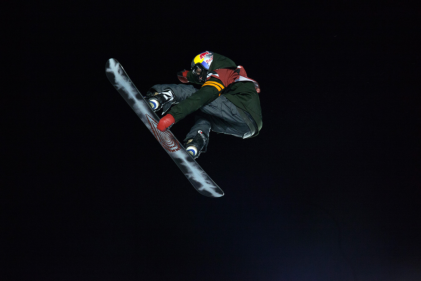 Lyon Farrell, the youngest member of the Big Air snowboard final, takes flight during the second round.