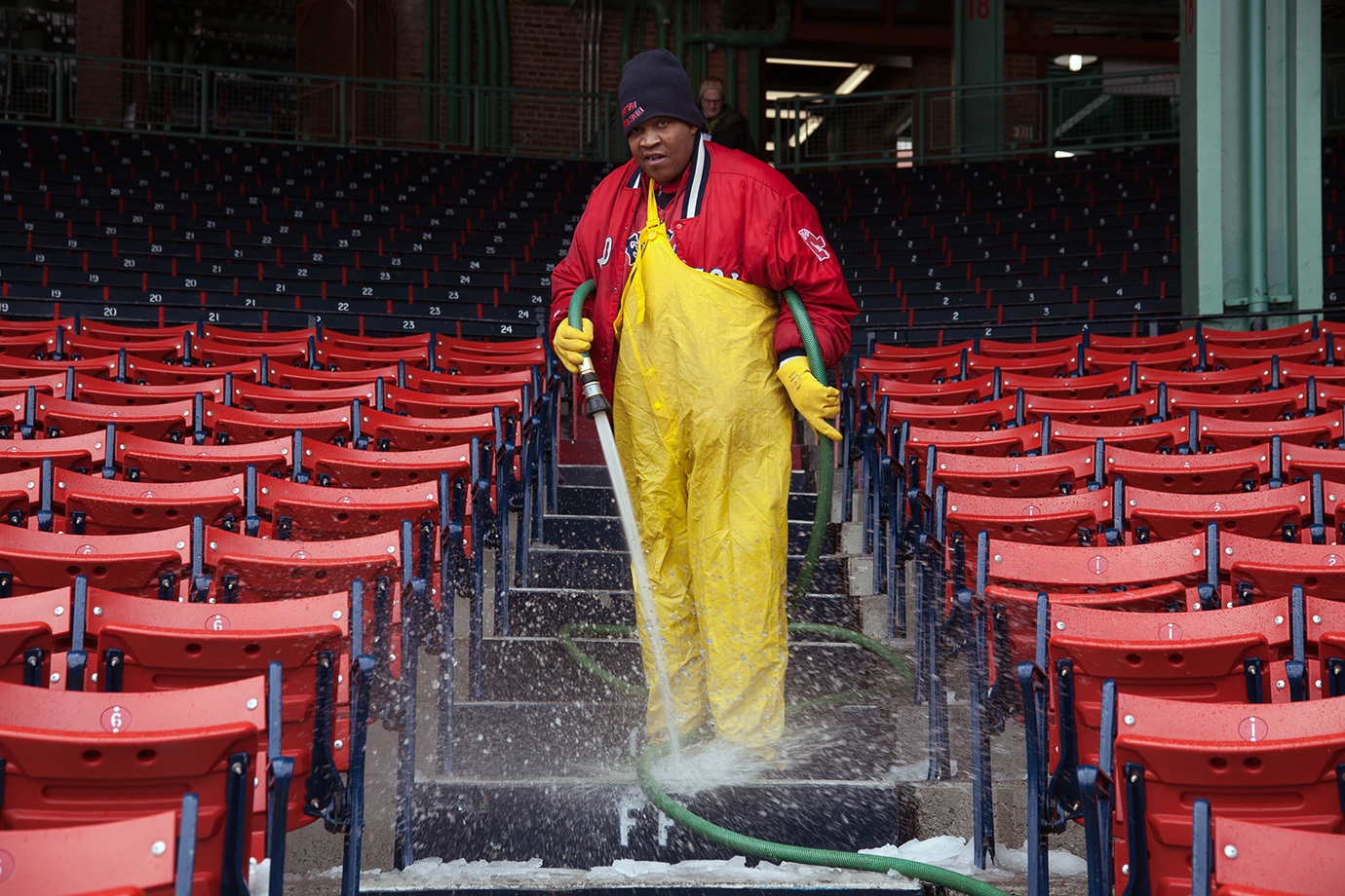 A member of the Fenway Park grounds crew prepares the lower bowl seating for the big crowds expected for the two-night event.