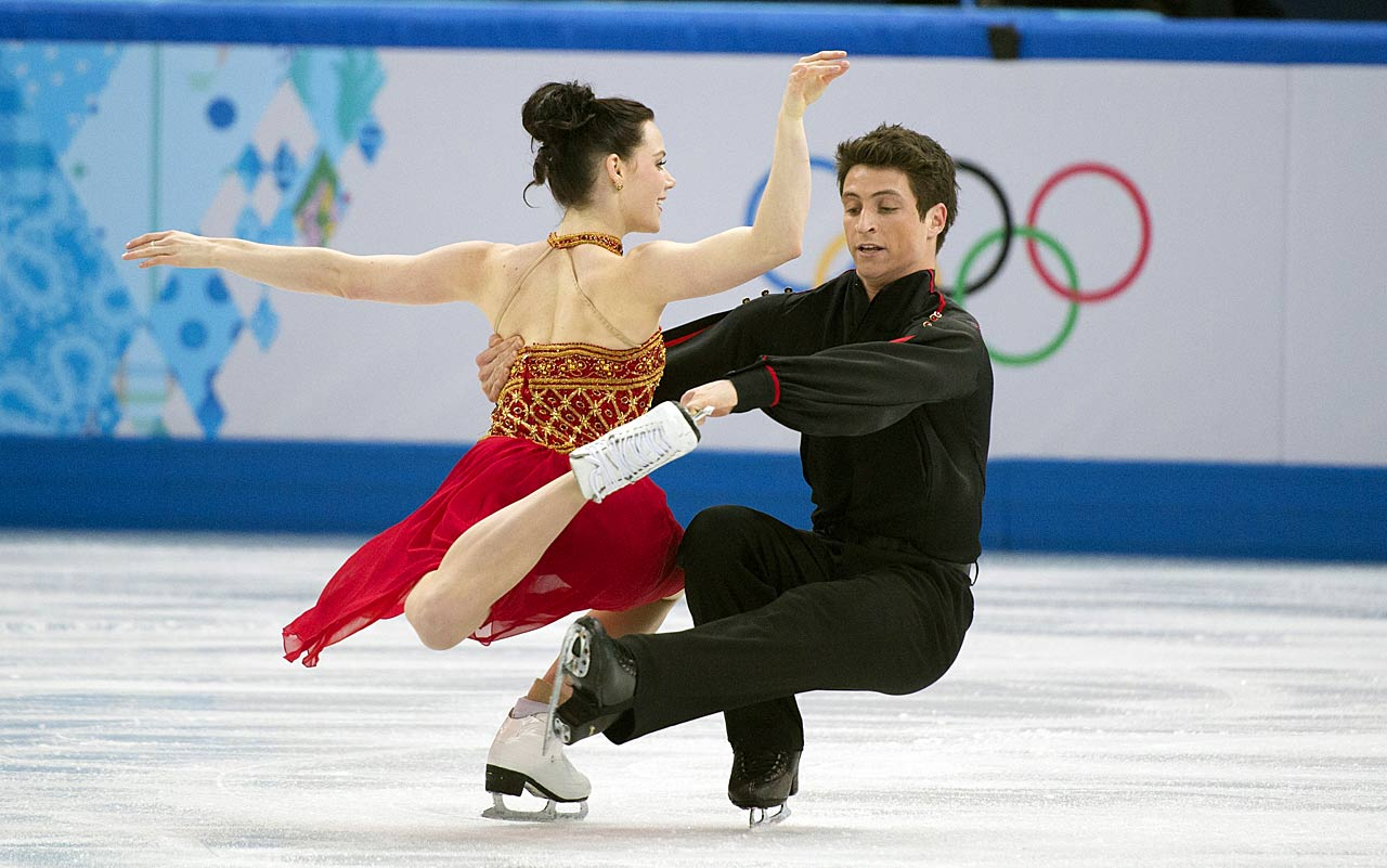 Tessa Virtue and Scott Moir of Canada compete in the Team Ice Dance Free Dance.
