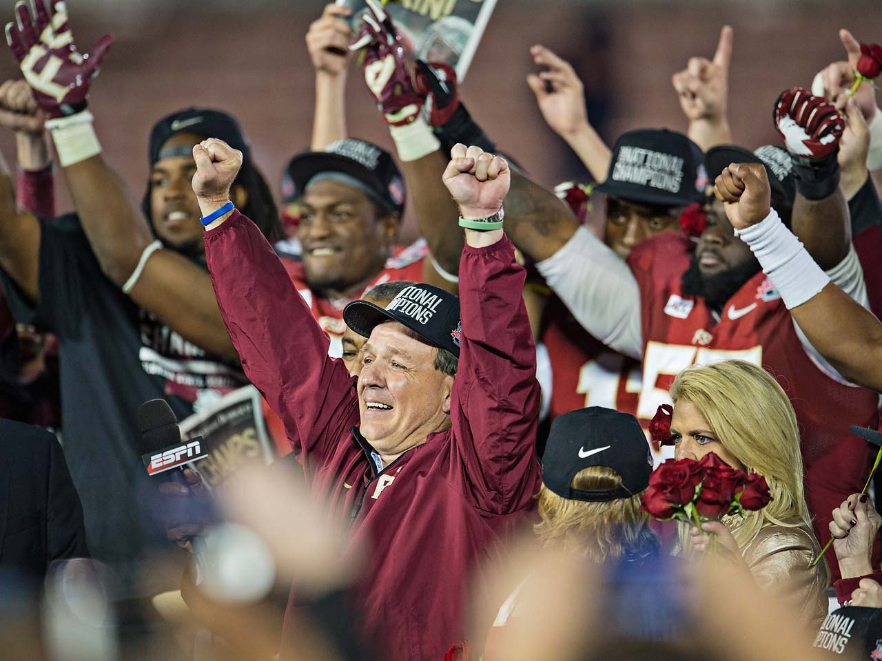 Jimbo Fisher and Florida State players with their hands in the air after they received the national championship trophy following their victory over Auburn.  It's a great achievement for Coach Fisher, as it's the storied coach's first-ever national title in a coaching career spanning more than 25 years.