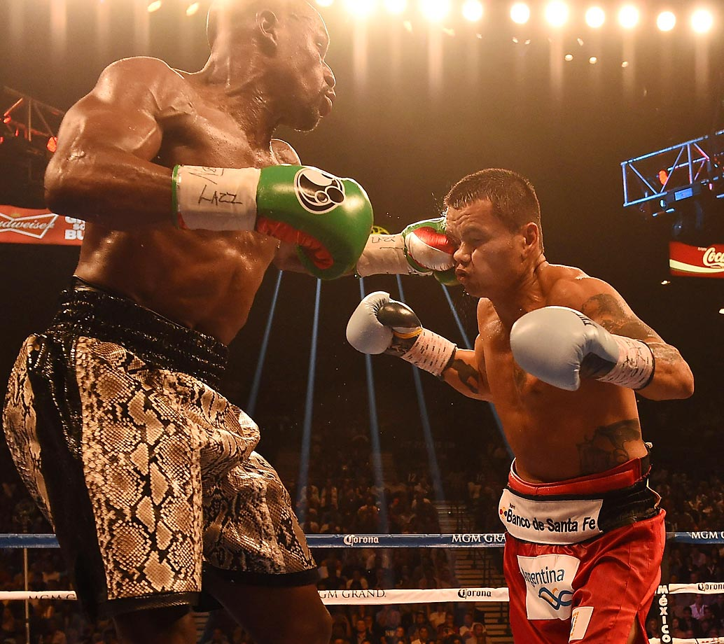 Floyd Mayweather Jr. lands a punch on Marcos Maidana in their rematch. Mayweather won via unanimous decision.