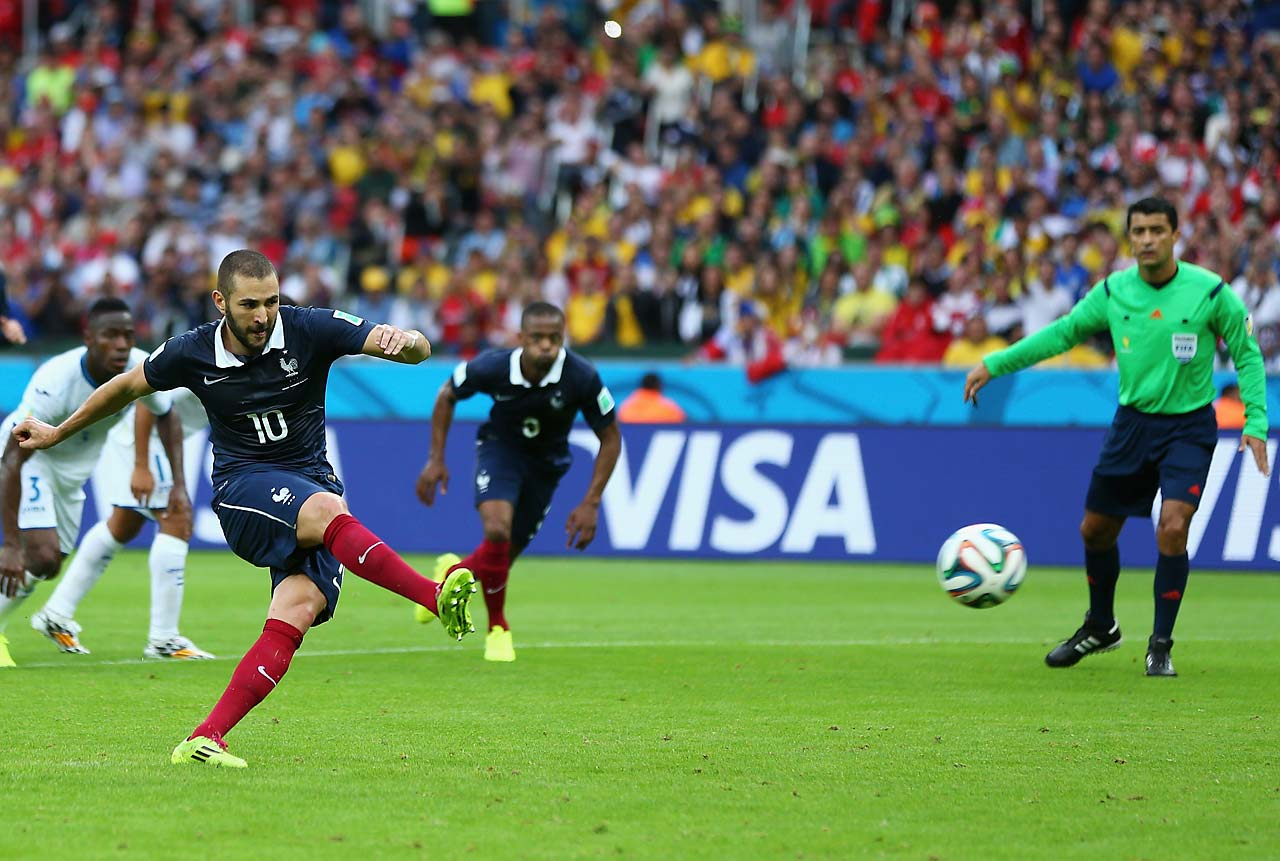 Karim Benzema of France shoots and scores his team's first goal on a penalty kick against Honduras at Estadio Beira-Rio on June 15. France won 3-0.
