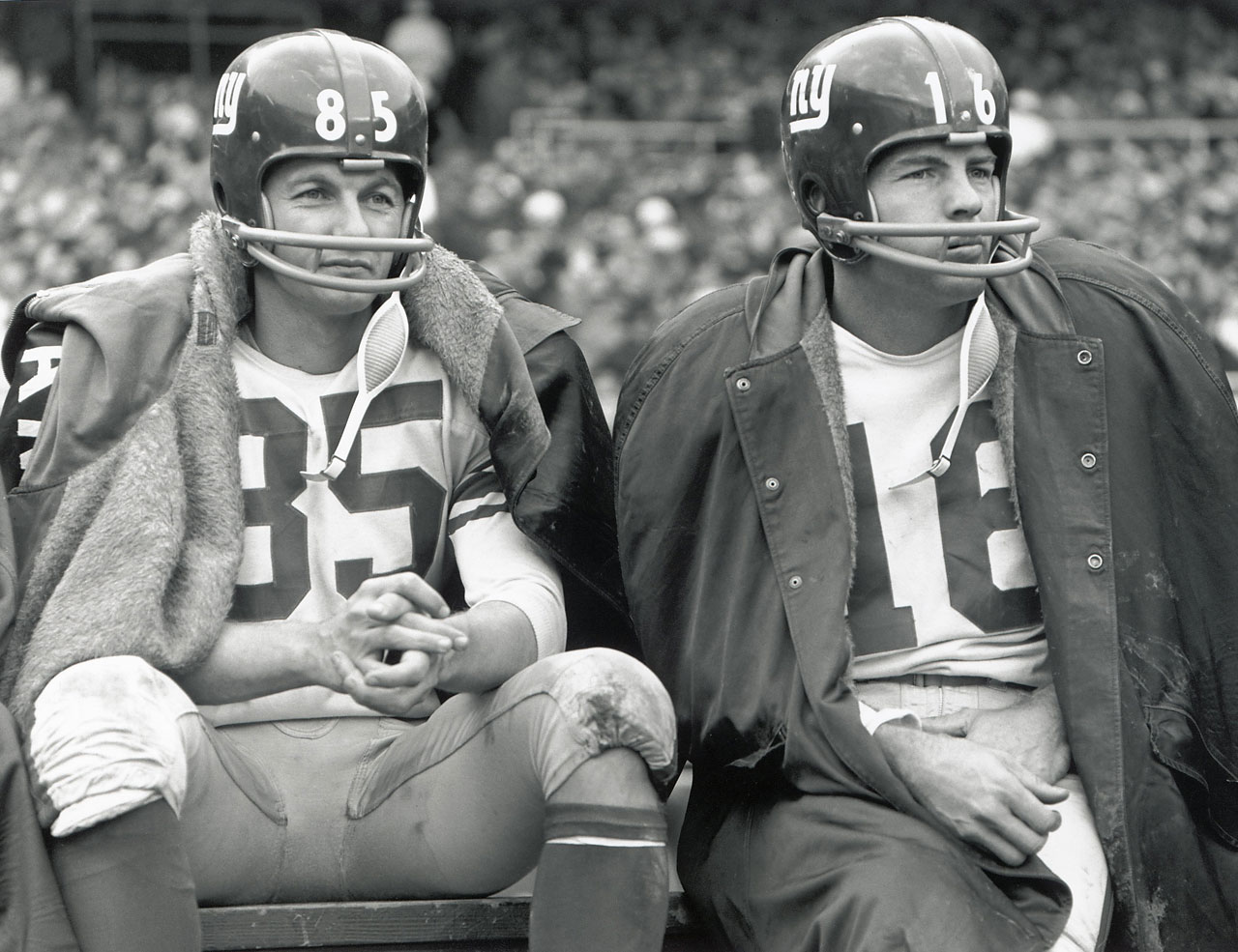 Del Shofnel, left, and Frank Gifford of the New York Giants sit on the bench during a game, circa 1962-64.