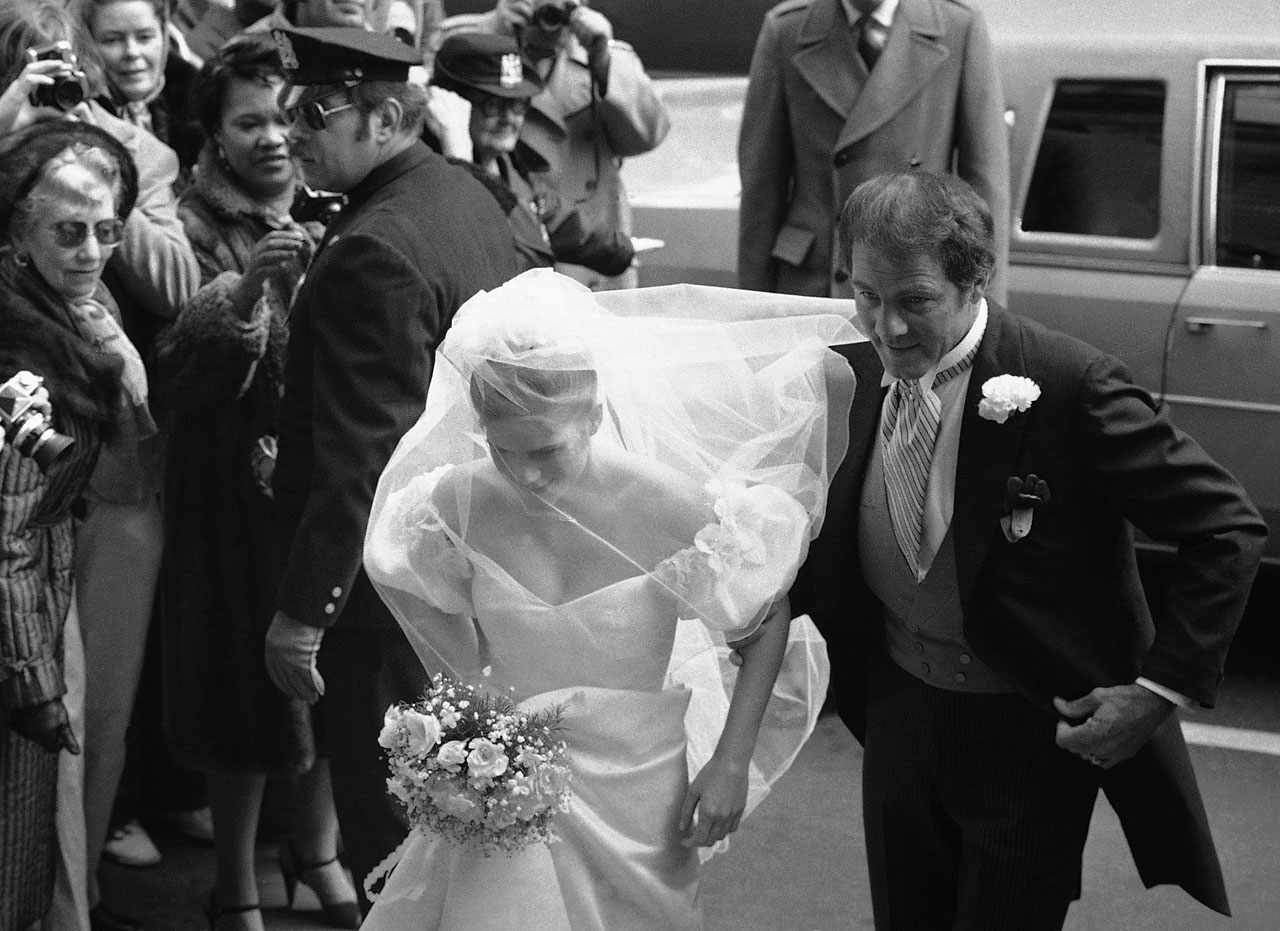 Frank Gifford escorts his daughter Vicki into New York's St. Ignatius Loyola Catholic Church onMarch 14, 1981, for her wedding with Michael Kennedy, son of the late Sen. Robert Kennedy.