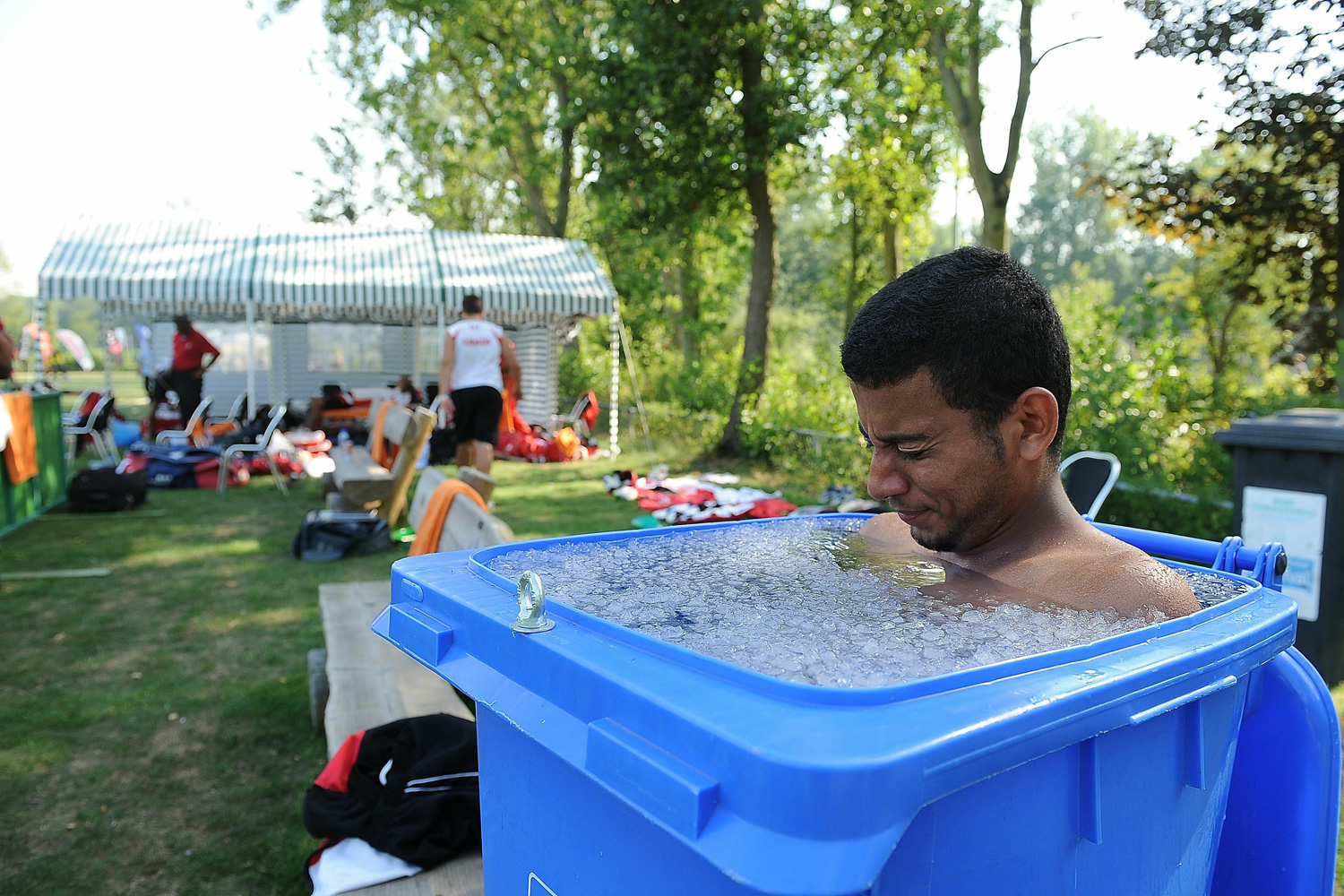 First class cricketer Manny Aulakh sits in an ice bath up to his shoulders during the ICC World Cricket League Division One match between Canada and Kenya.
