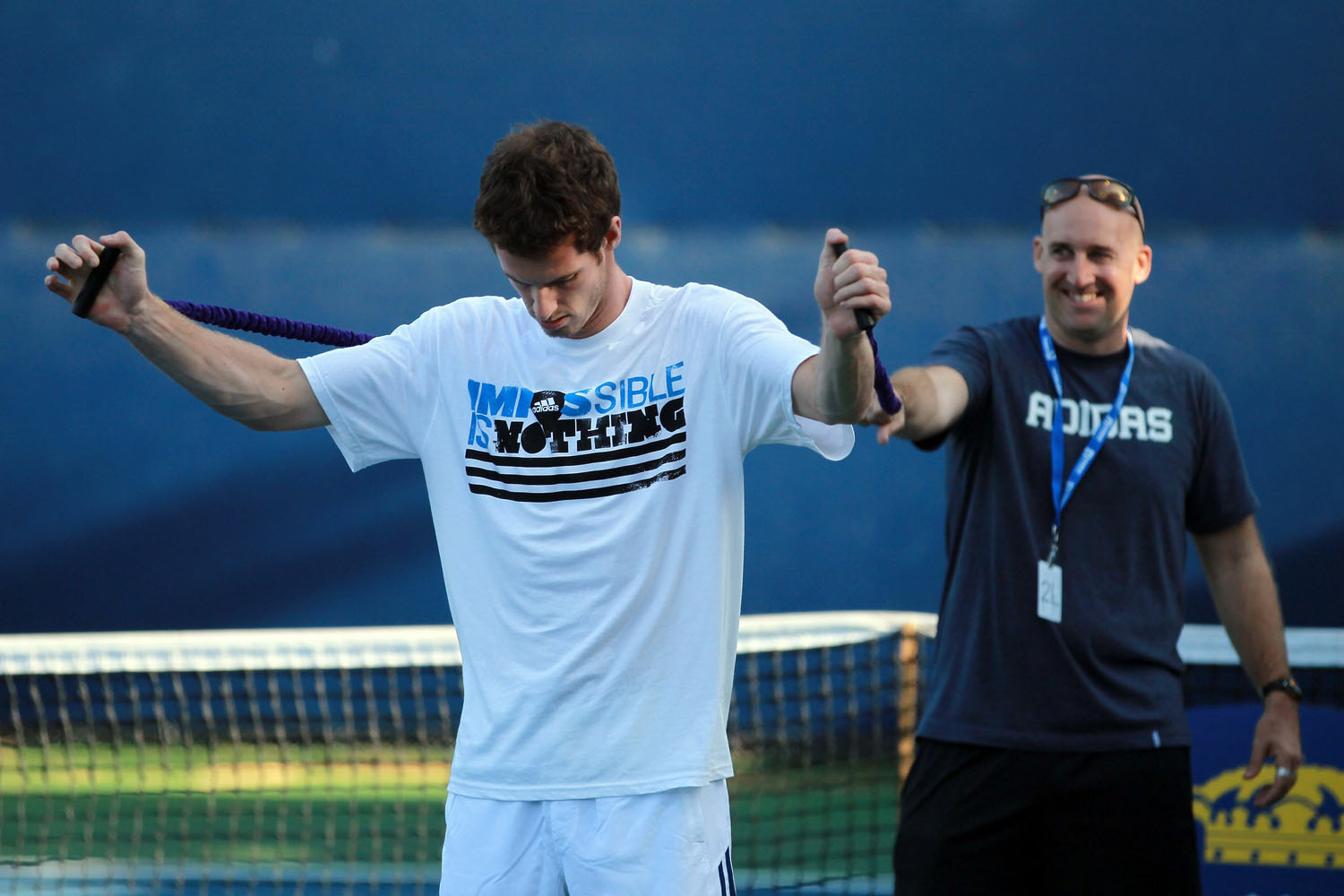 Andy Murray works out with strength and conditioning coach Jez Green prior to practicing during the Farmers Classic at the Los Angeles Tennis Center in July 2010.