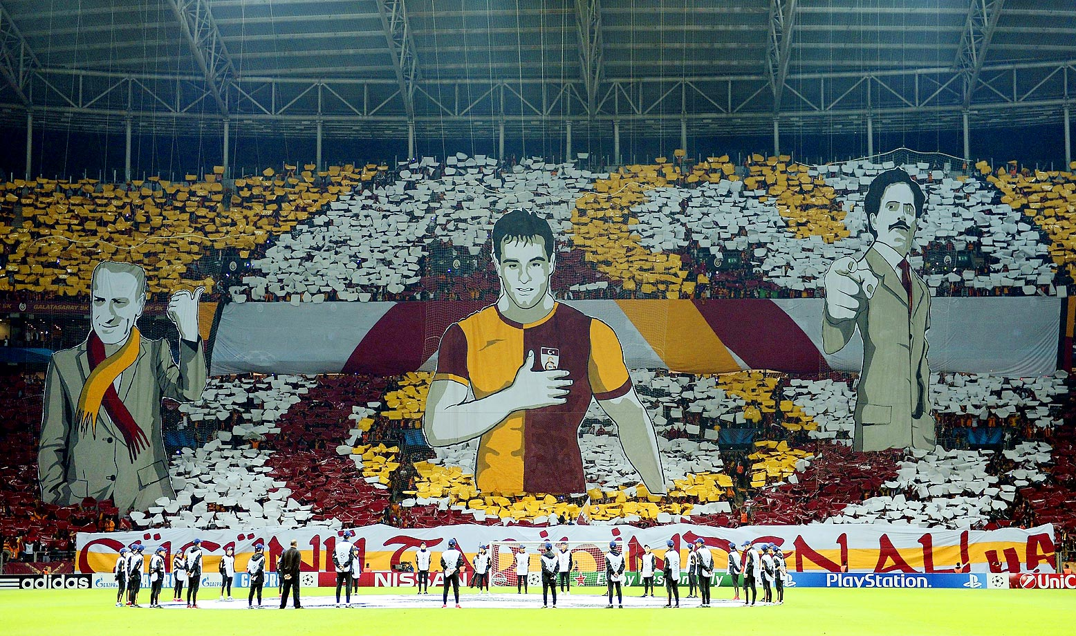 Galatasaray fans support their team during the UEFA Champions League Group D match between Borussia Dortmund and Galatasaray at the Turk Telekom Arena in Istanbul.