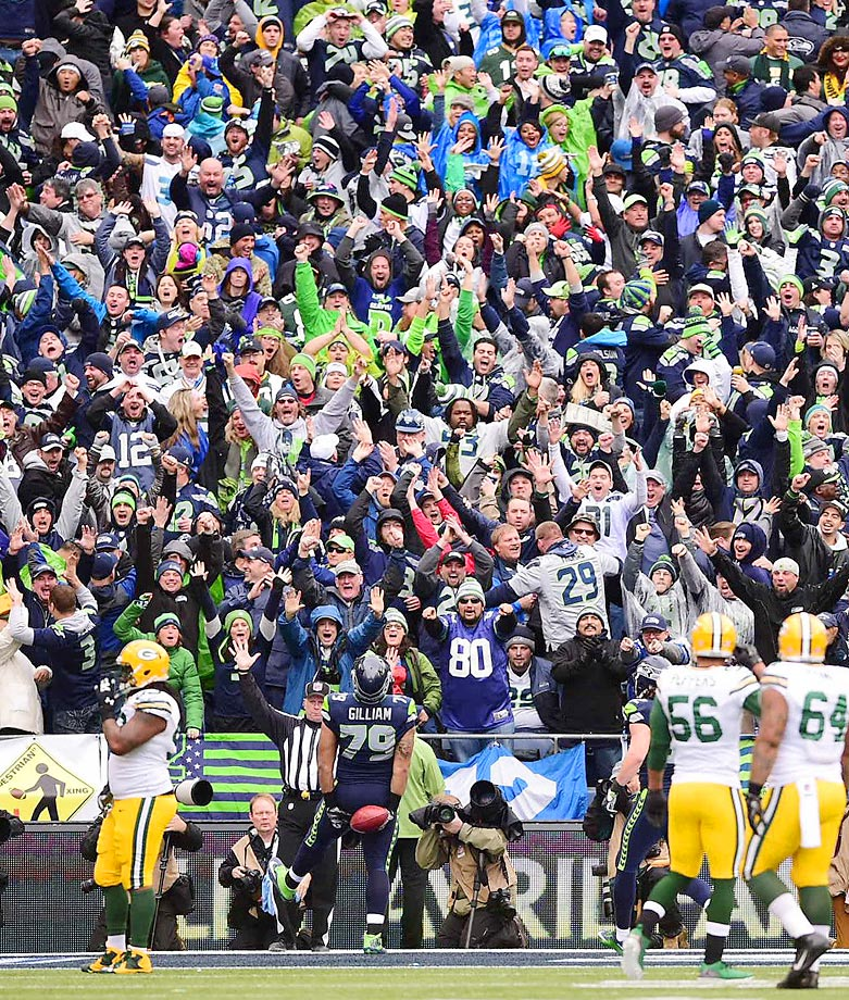 Seattle Seahawks tackle Garry Gilliam (79) celebrates his touchdown reception off a fake field foal during the NFC Championship Game between the Seahawks and Green Bay Packers at CenturyLink Field in Seattle on Jan. 18.