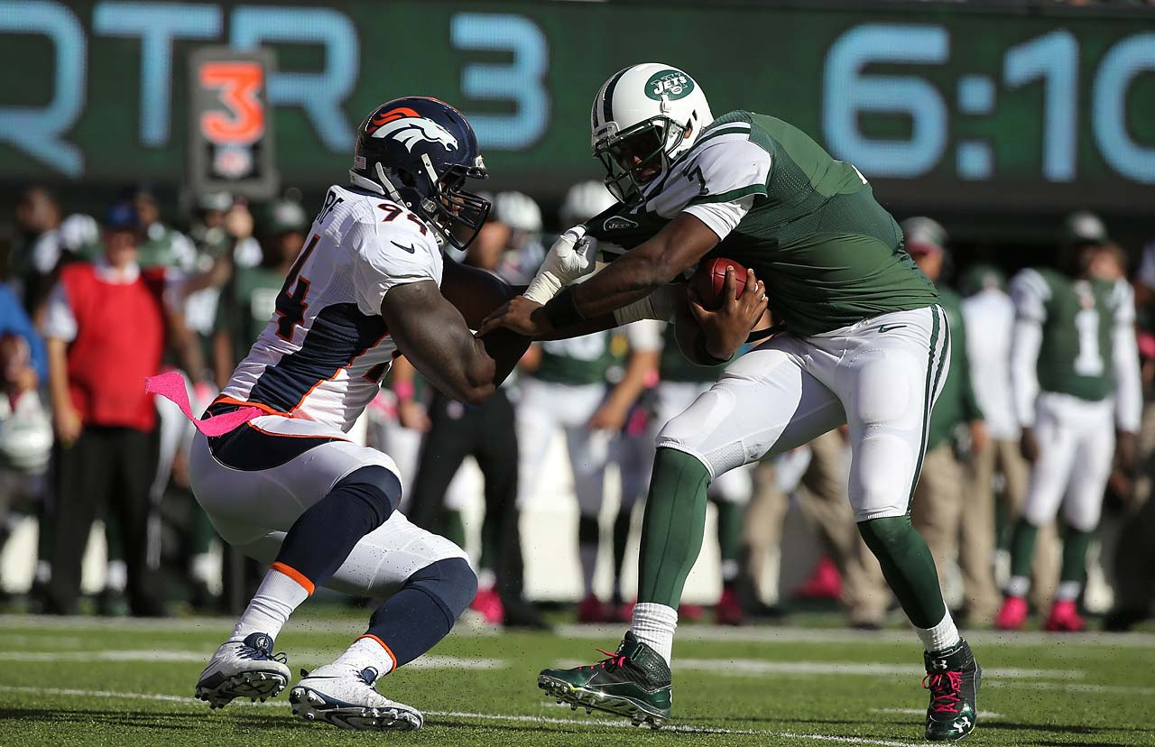 DeMarcus Ware of the Denver Broncos tries to pull down Jets quarterback Geno Smith.