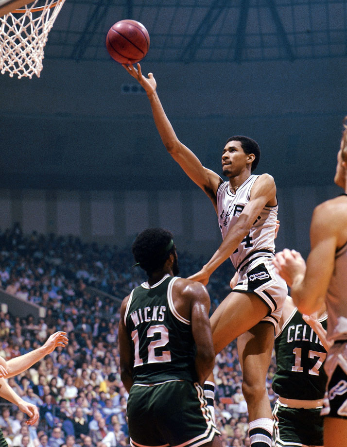 "One thing he could do was finger roll.  From anywhere.  Another was score in bunches, including 33 points in a quarter (and 63 in that game) to win the 1978 scoring title.  ""He's the one player I would pay to see,"" said Jerry West.  Yep."