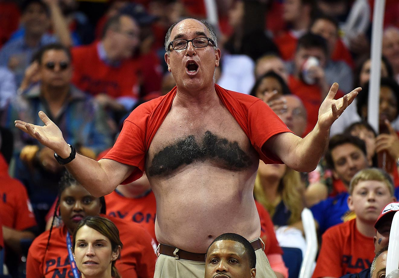 A New Orleans Pelicans fan cheers for his team in a game against the Golden State Warriors.