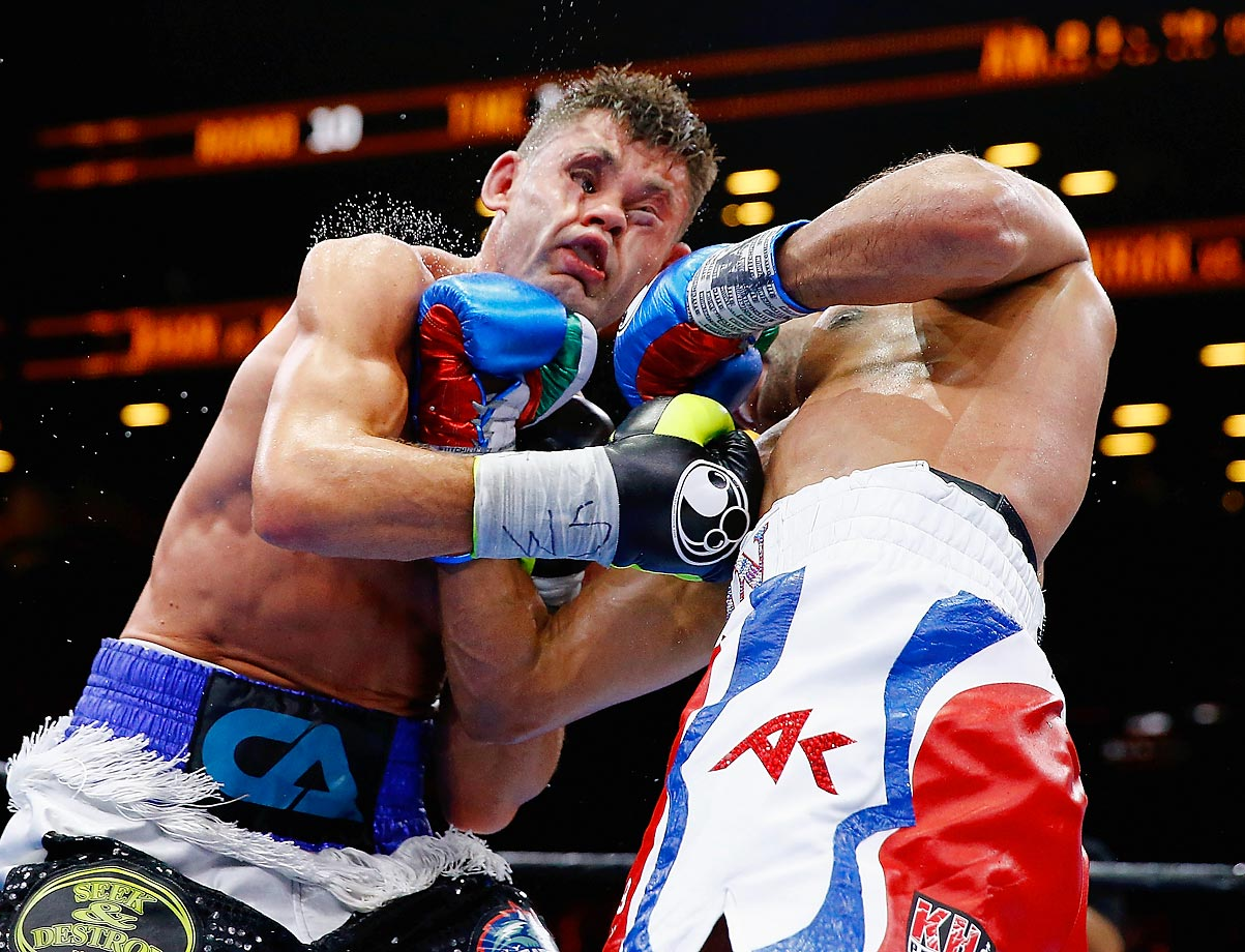 Amir Khan punches Chris Algieri in a welterweight bout in New York City.