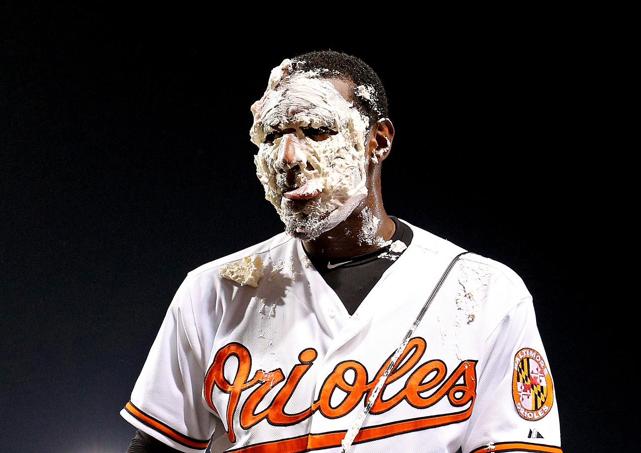 Adam Jones of the Baltimore Orioles gets a victory pie to the face from teammate Manny Machado (not pictured) after playing hero in his team's win over the Boston Red Sox on June 10.