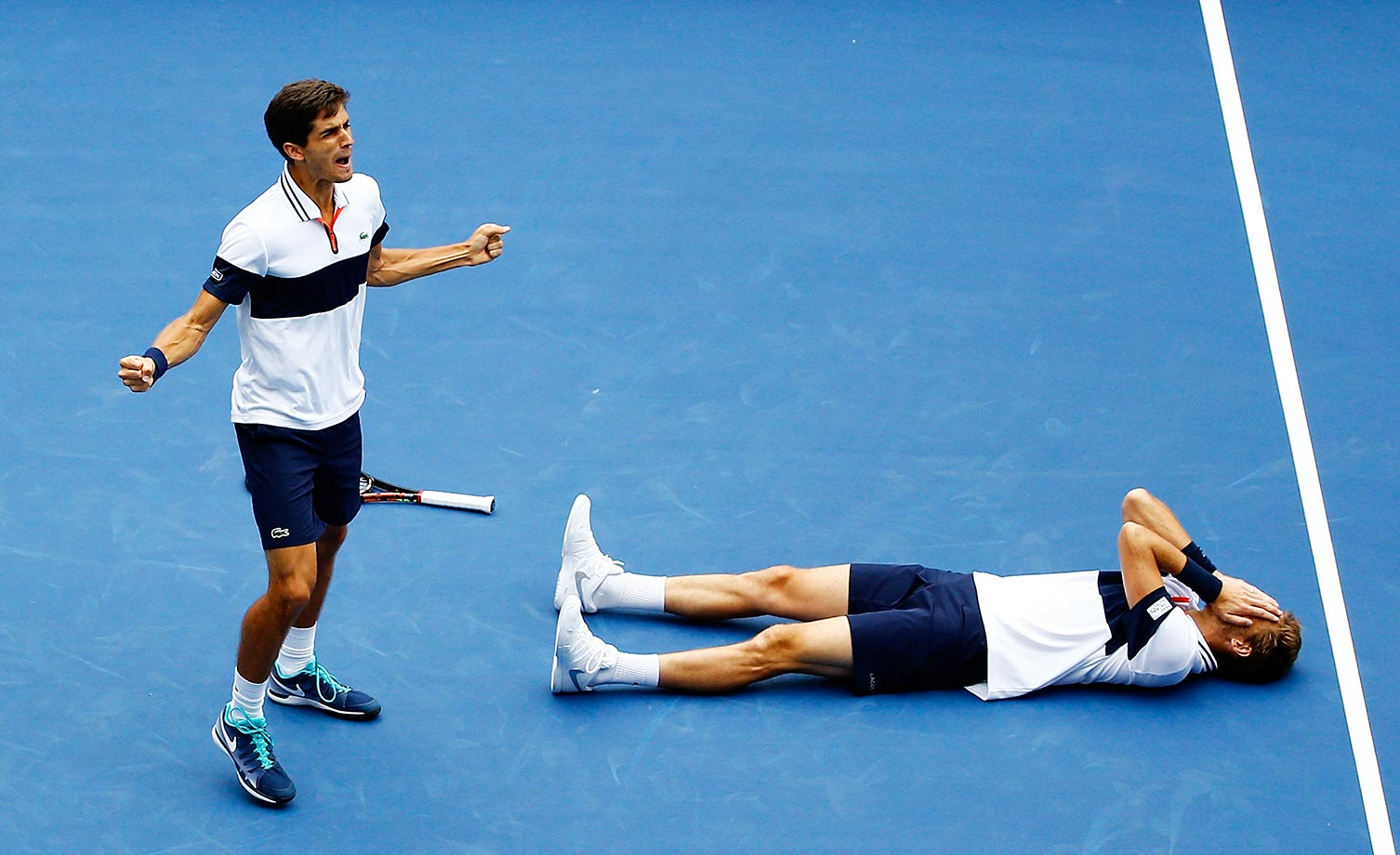 Pierre-Hugues Herbert (left) and Nicolas Mahut celebrate winning their doubles match against Jamie Murray and John Peers at the U.S. Open.