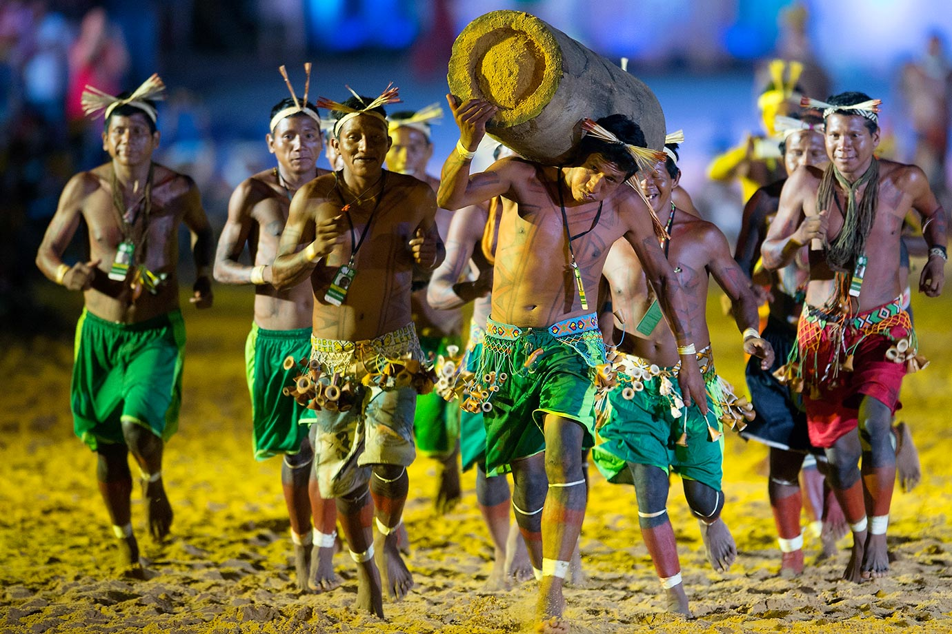 A man carries a painted log during the opening ceremony of the first World Games for Indigenous People in Palmas, Brazil.
