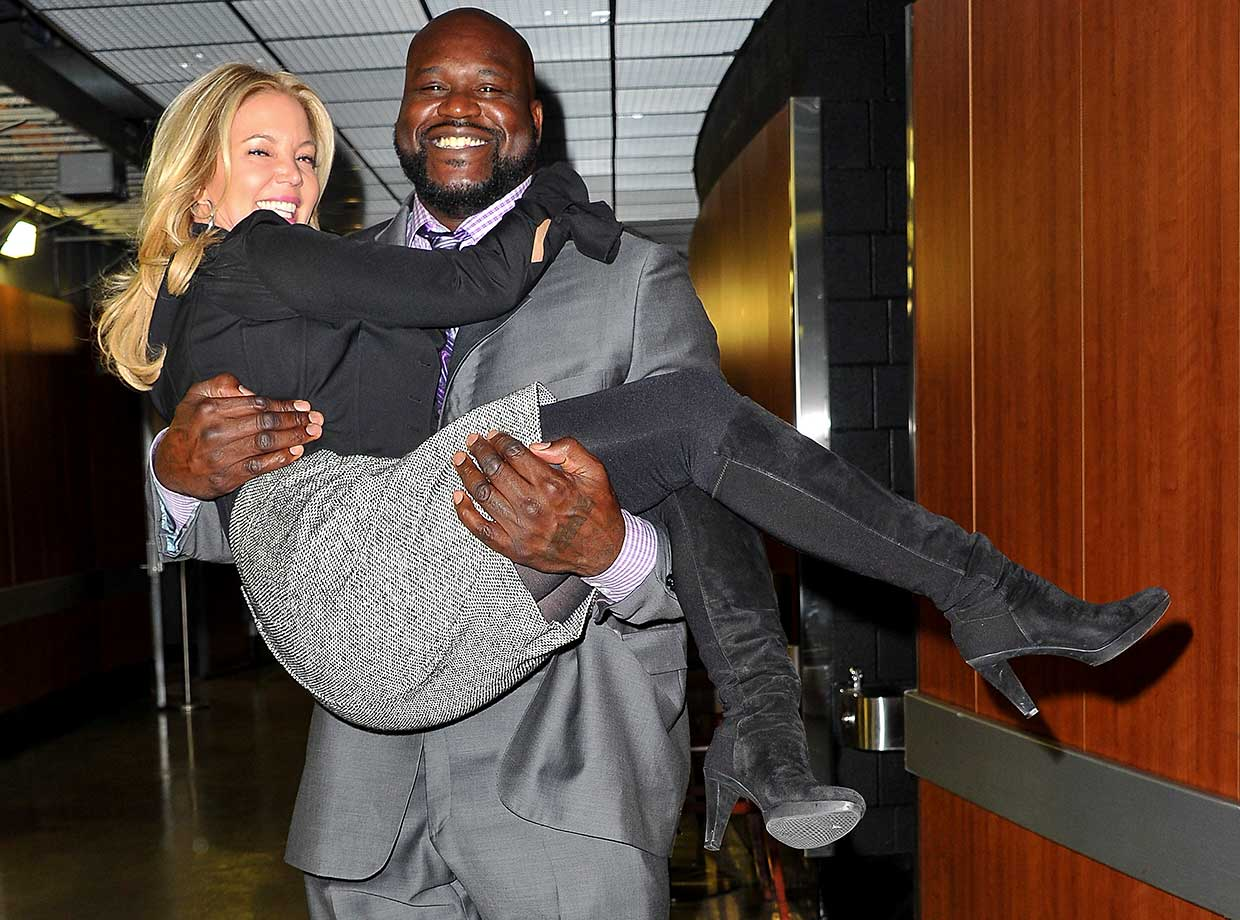 Former  NBA player Shaquille O'neal holds up Lakers' owner and president Jeanie Buss during the 12th Annual Lakers All-Access at Staples Center in Los Angeles.