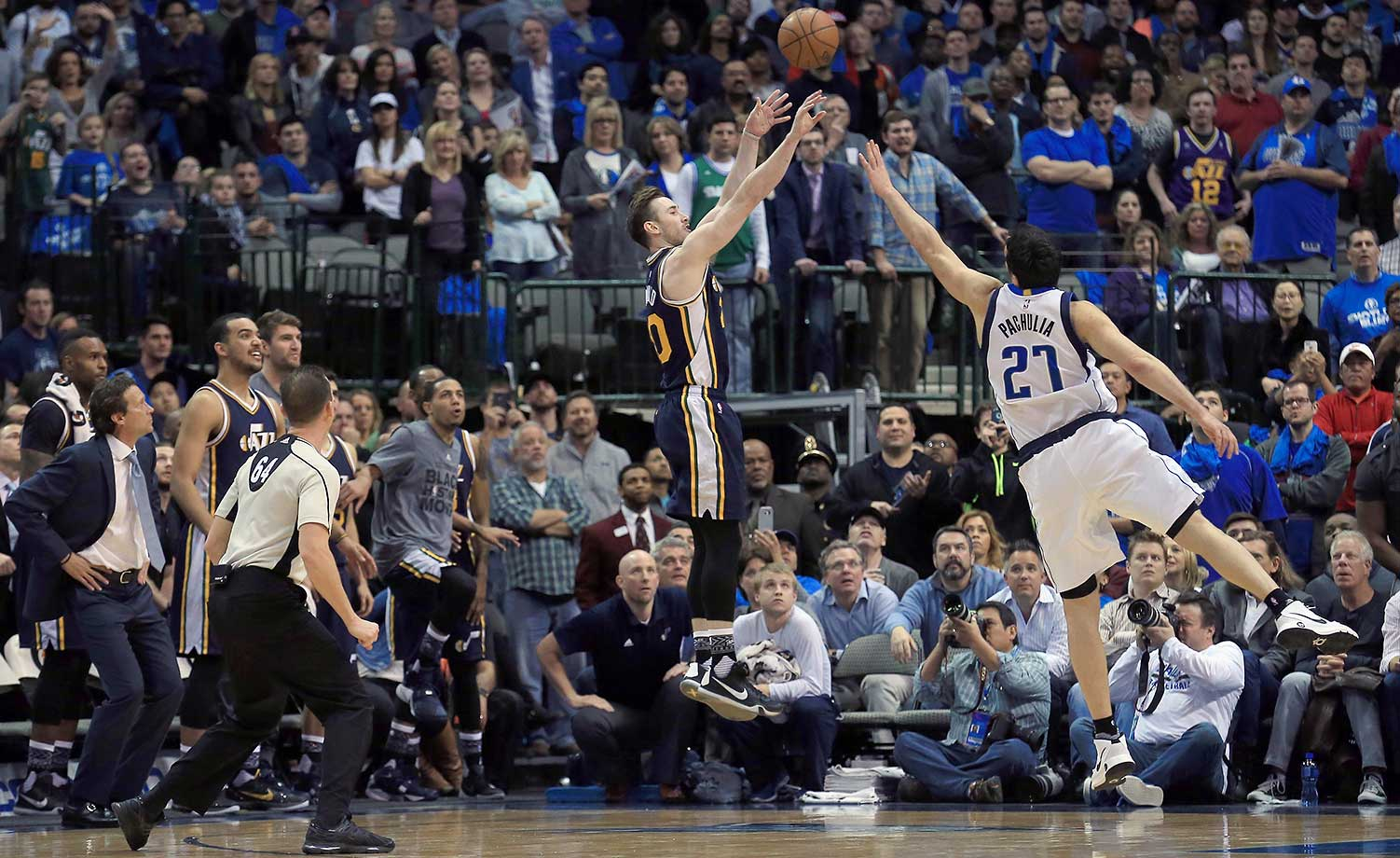 Gordon Hayward of the Utah Jazz shoots the game-winning basket against Zaza Pachulia of the Dallas Mavericks in overtime.