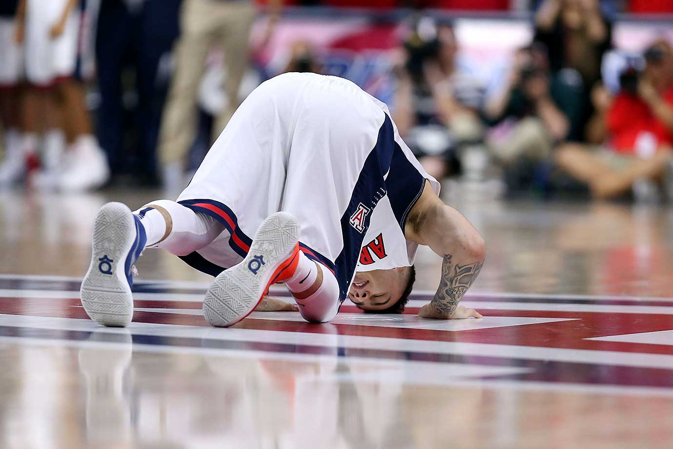 Gabe York of Arizona kisses the Arizona logo during a 94-62 win over Stanford.