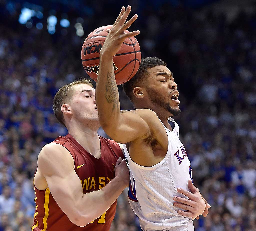 Kansas' Frank Mason gets tangled up with Iowa State's Matt Thomas as they battle for a loose ball.