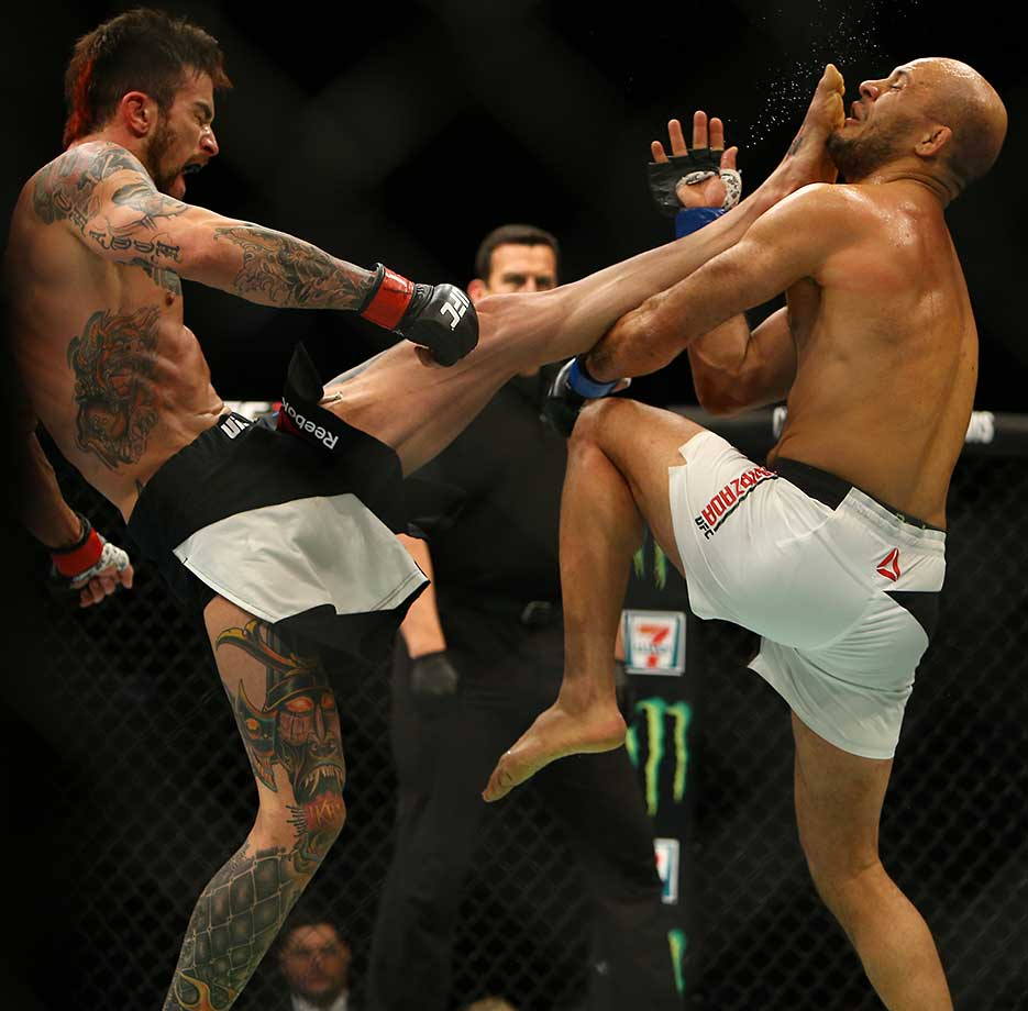 Brandon Thatch kicks Siyar Bahadurzada during UFC 196.