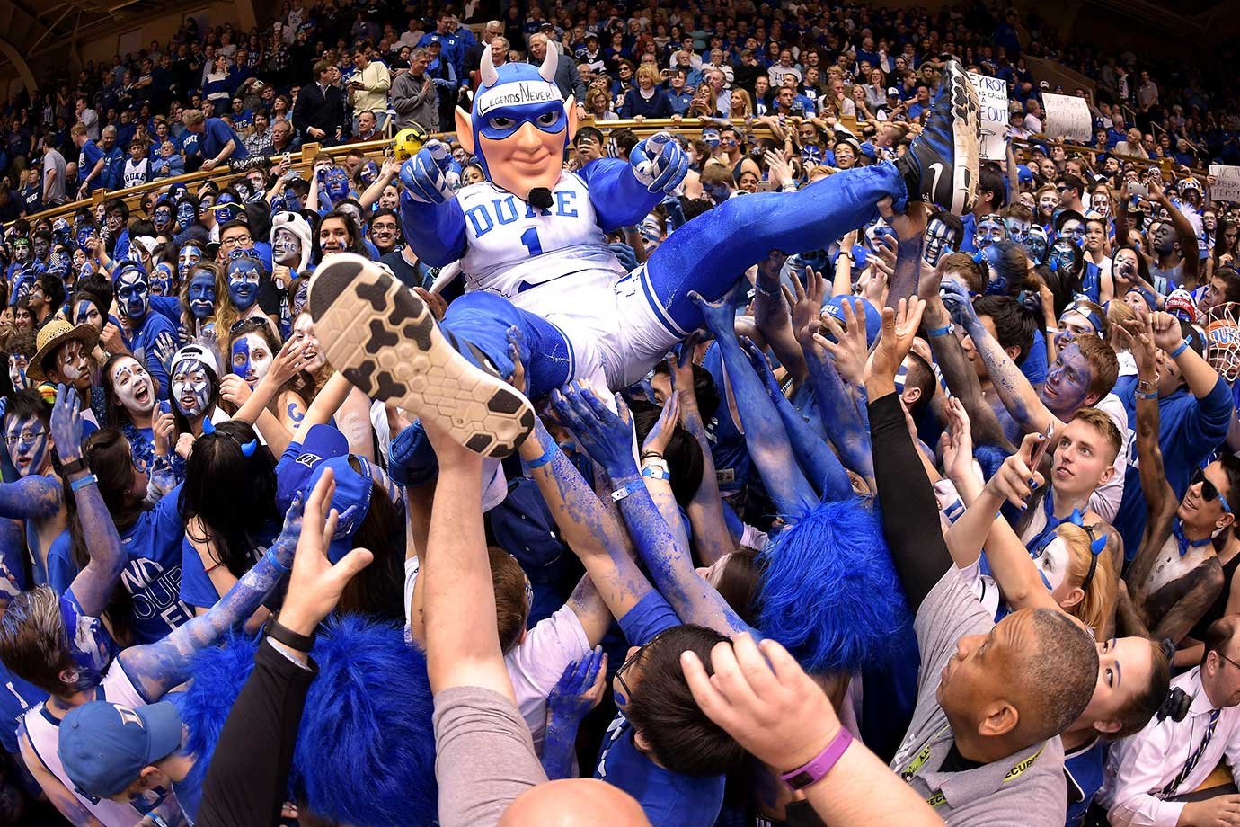 The mascot of Duke crowd surfs over the Cameron Crazies prior to their game against North Carolina.