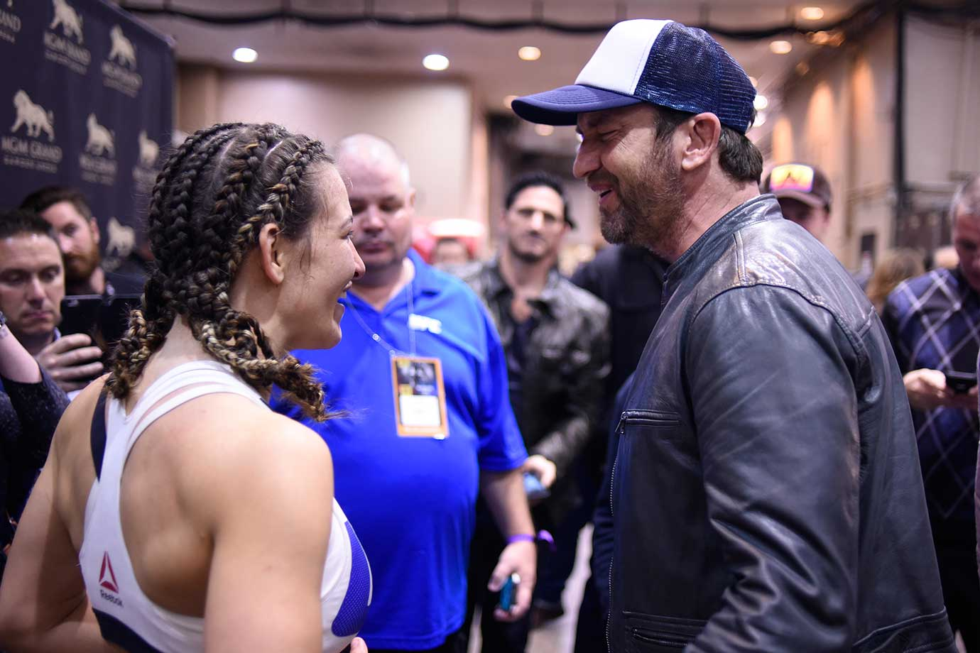 Miesha Tate and actor Gerard Butler, the star of London Has Fallen, chat backstage at UFC 196 in Las Vegas.