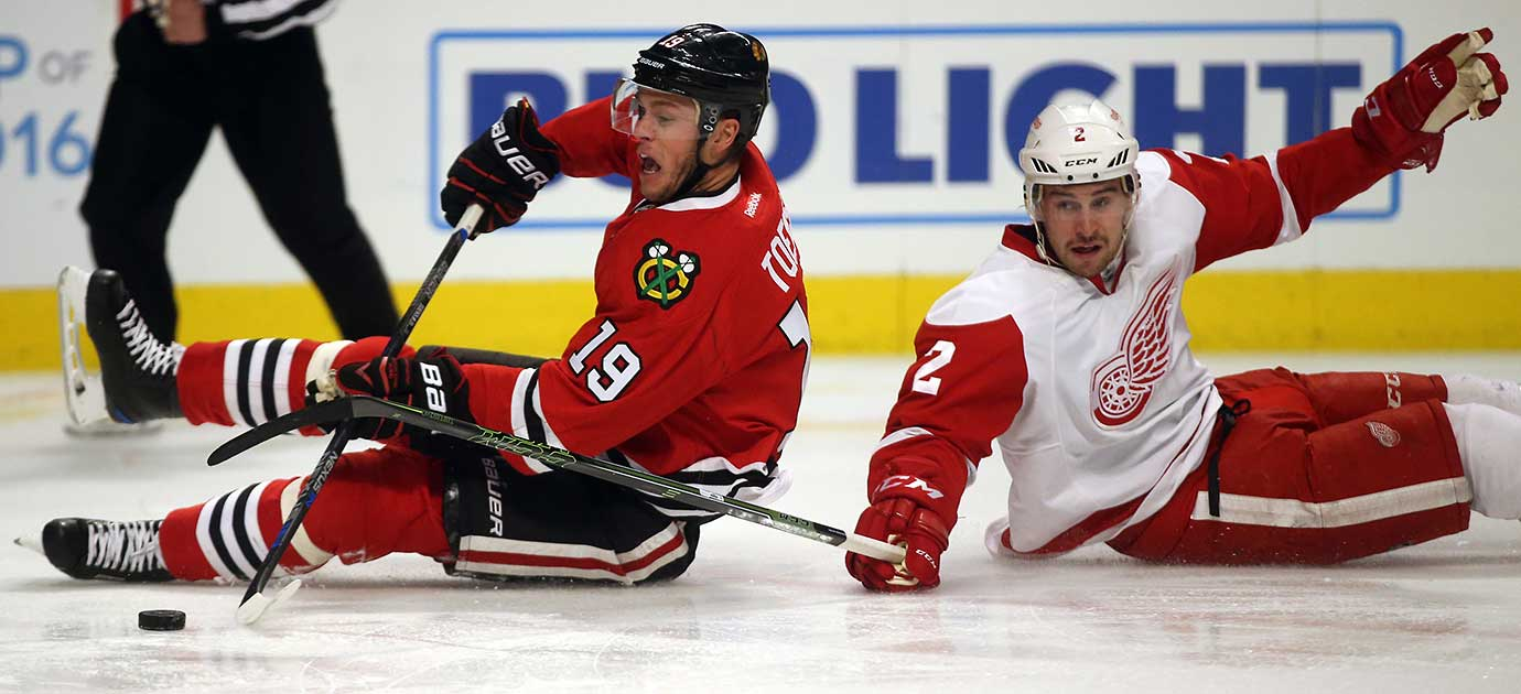 Chicago center Jonathan Toews (19) tries to shoot from the ice around Detroit's Brendan Smith.