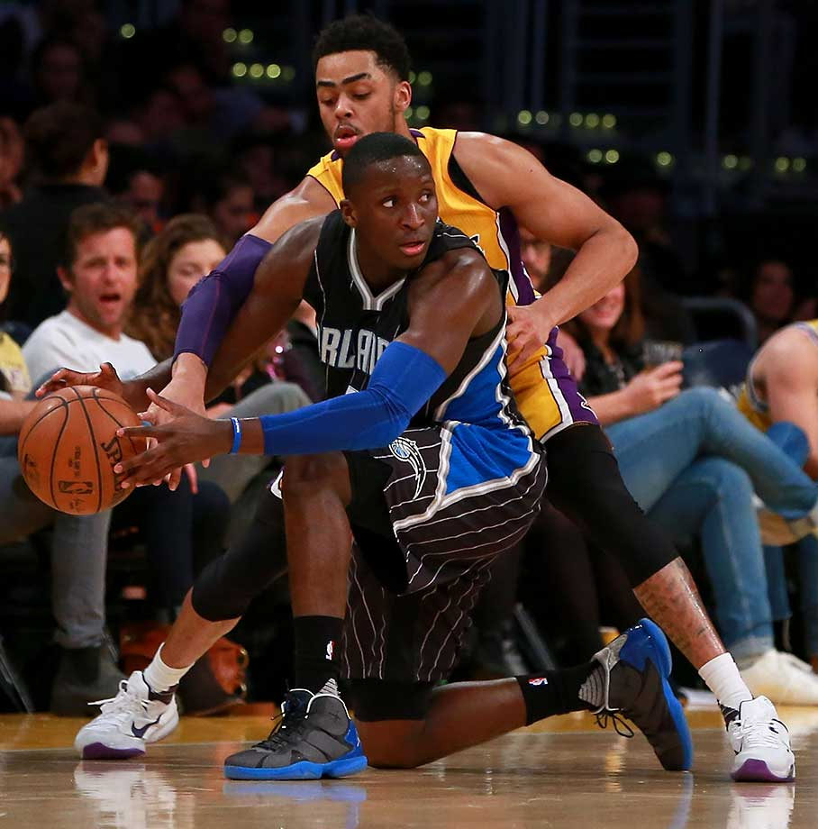 D'Angelo Russell of the Los Angeles Lakers tries to steal the ball from Victor Oladipo of the Orlando Magic.