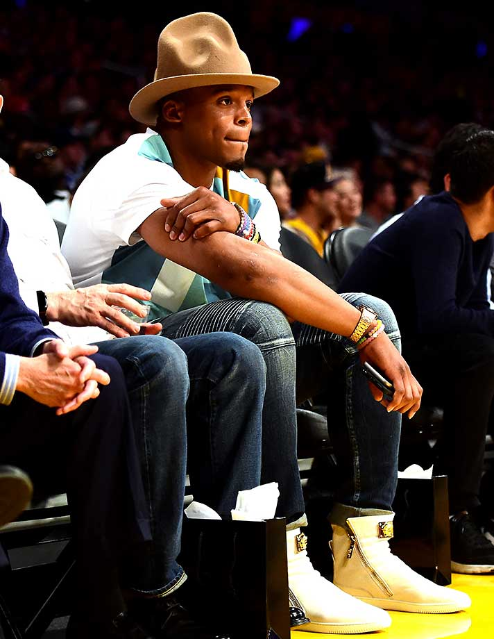 Cam Newton of the Carolina Panthers watches the Cleveland Cavaliers and the Los Angeles Lakers at Staples Center.