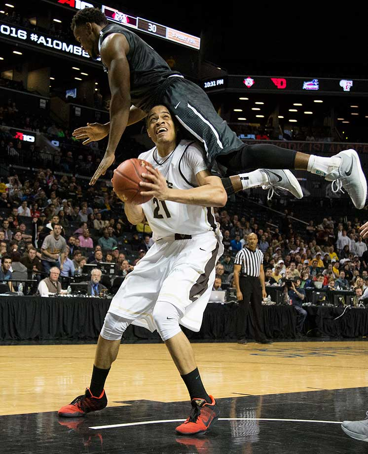 Nathan Ekwu of the Davidson Wildcats fouls Dion Wright of the St. Bonaventure Bonnies.
