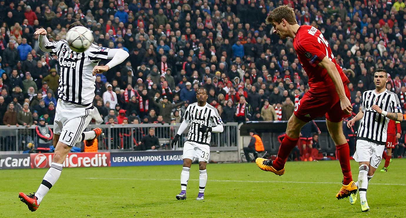 Thomas Mueller of Bayern Muenchen scores his team's second goal against Juventus.