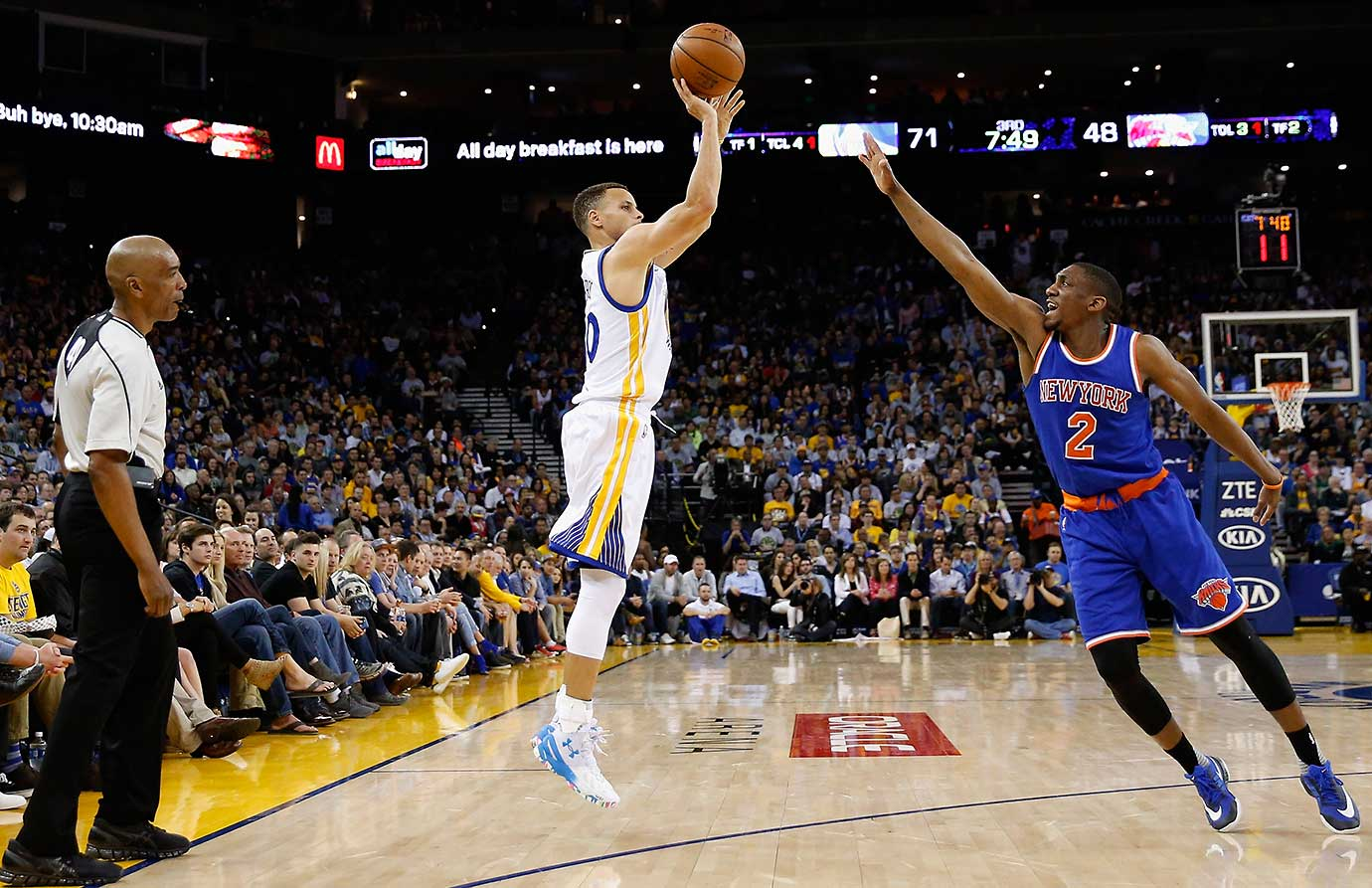 Steph Curry of the Warriors shoots a three-pointer over Langston Galloway of the New York Knicks. Curry scored 34 points across three quarters and sat out the fourth.