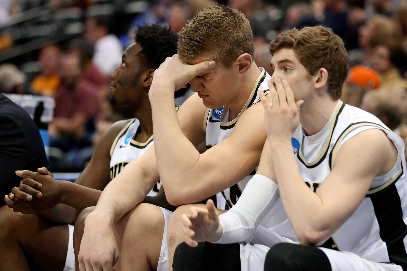 Members of the Purdue Boilermakers react during their loss to the Arkansas Little Rock Trojans.