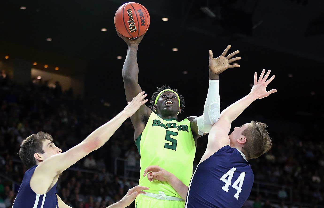 Johnathan Motley of Baylor drives to the basket against Sam Downey (44) of Yale during the Bears's upset loss to the Bulldogs.