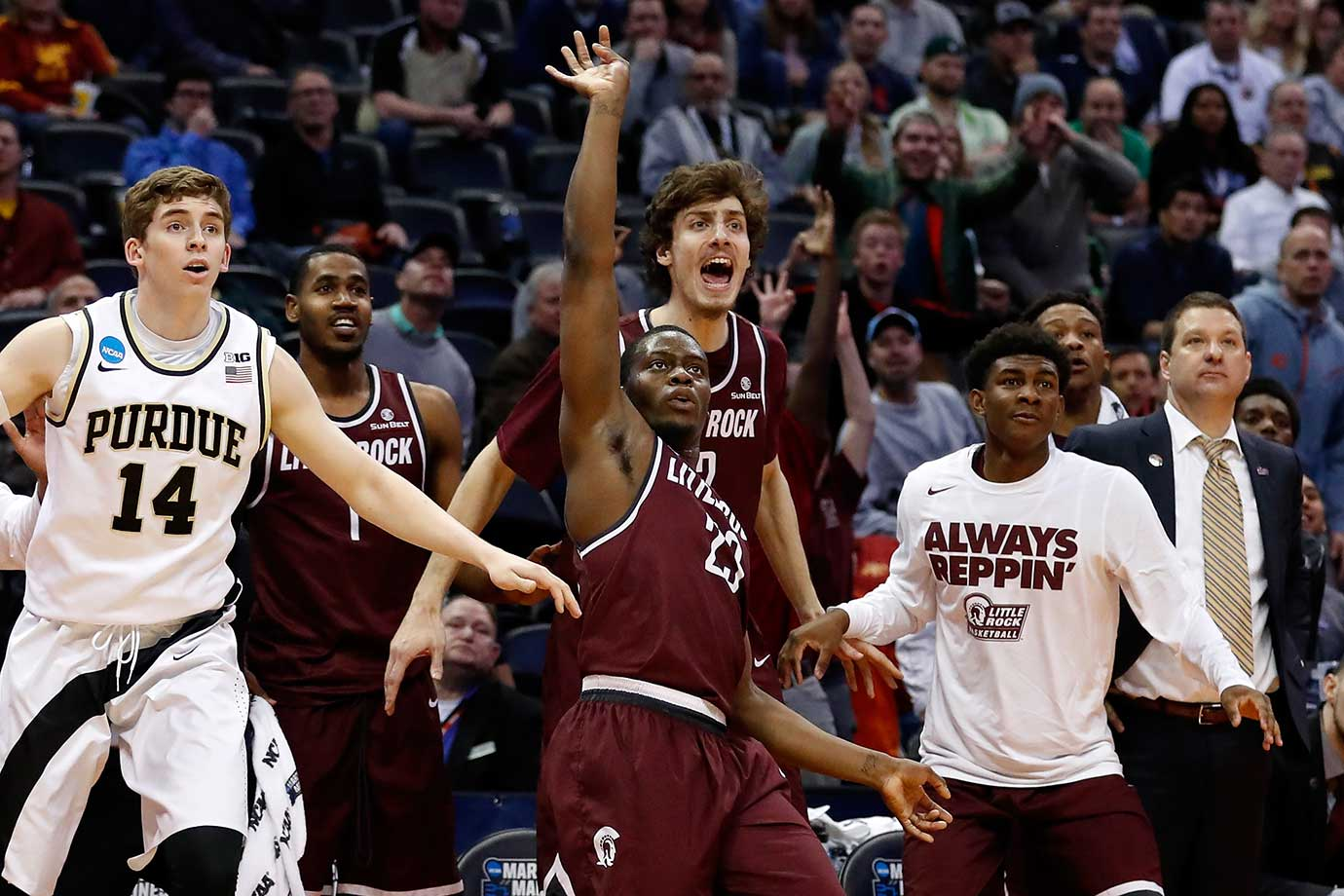 Kemy Osse of Arkansas Little Rock reacts after making a three-point shot over Ryan Cline of Purdue.