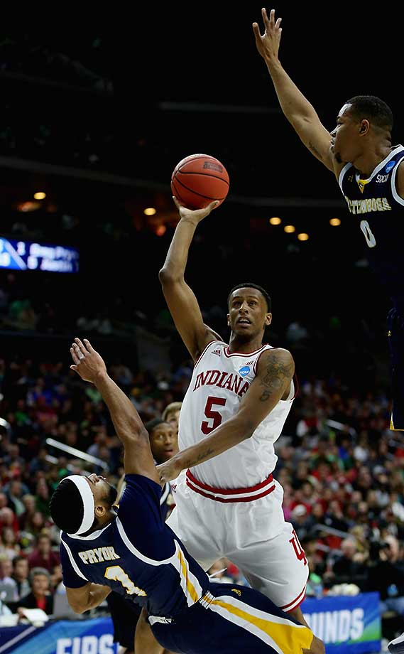 Troy Williams of Indiana is called for a charge against Greg Pryor of the Chattanooga Mocs.