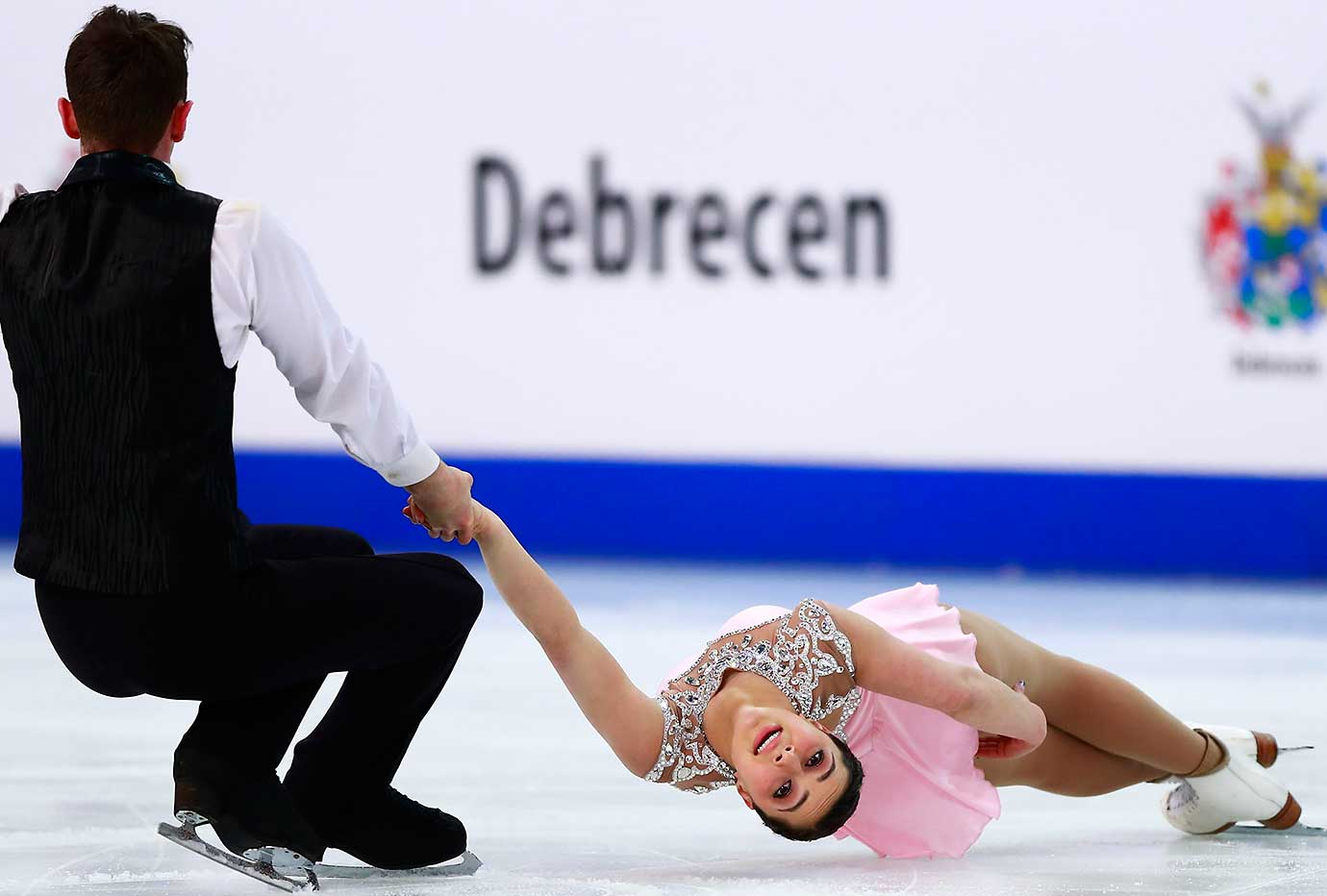 Lindsay Weinstein and Jacob Simon from the U.S. skate during the ISU World Junior Figure Skating Championships in Debrecen, Hungary.