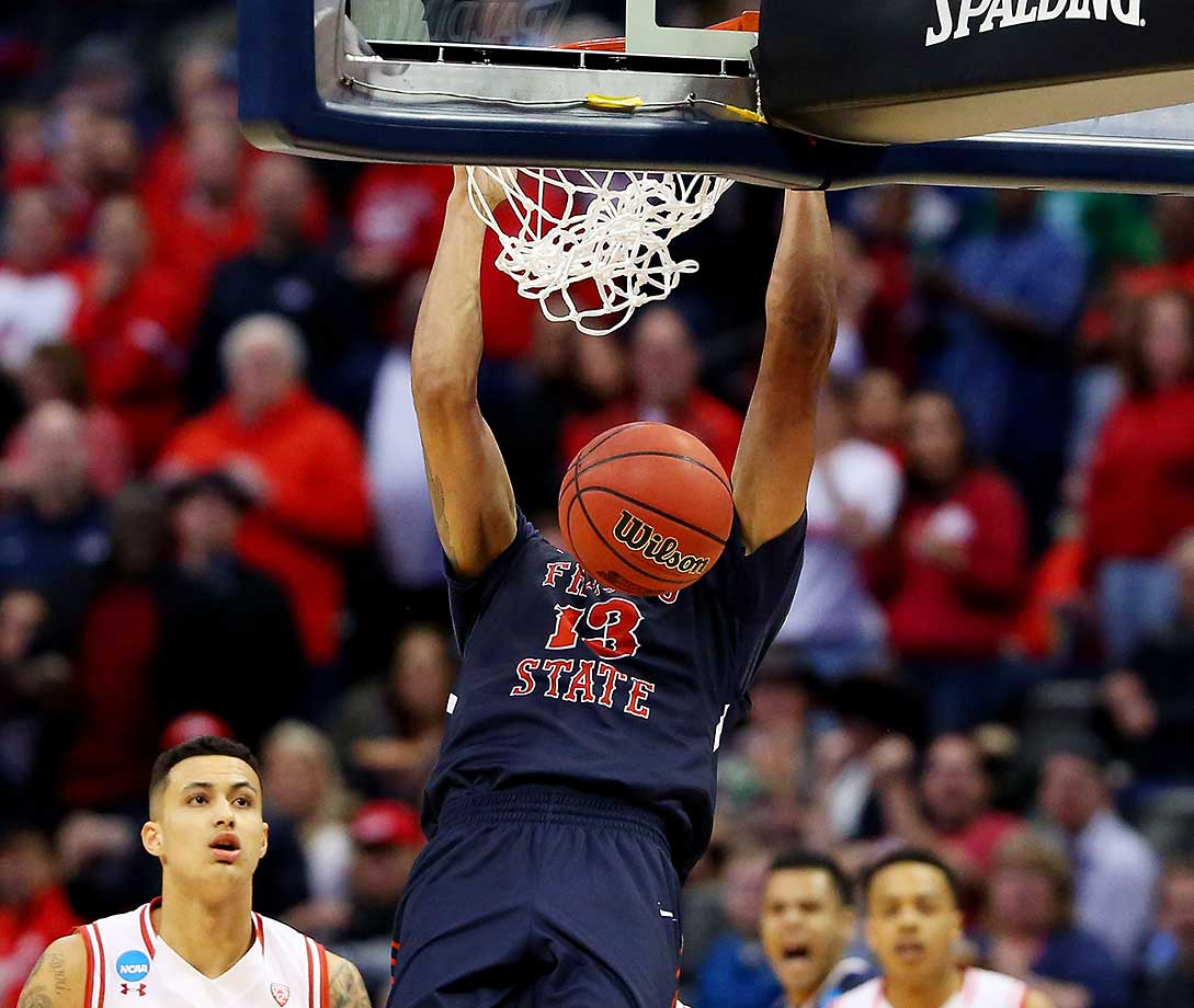 Cullen Russo of Fresno State dunks against the Utah Utes.
